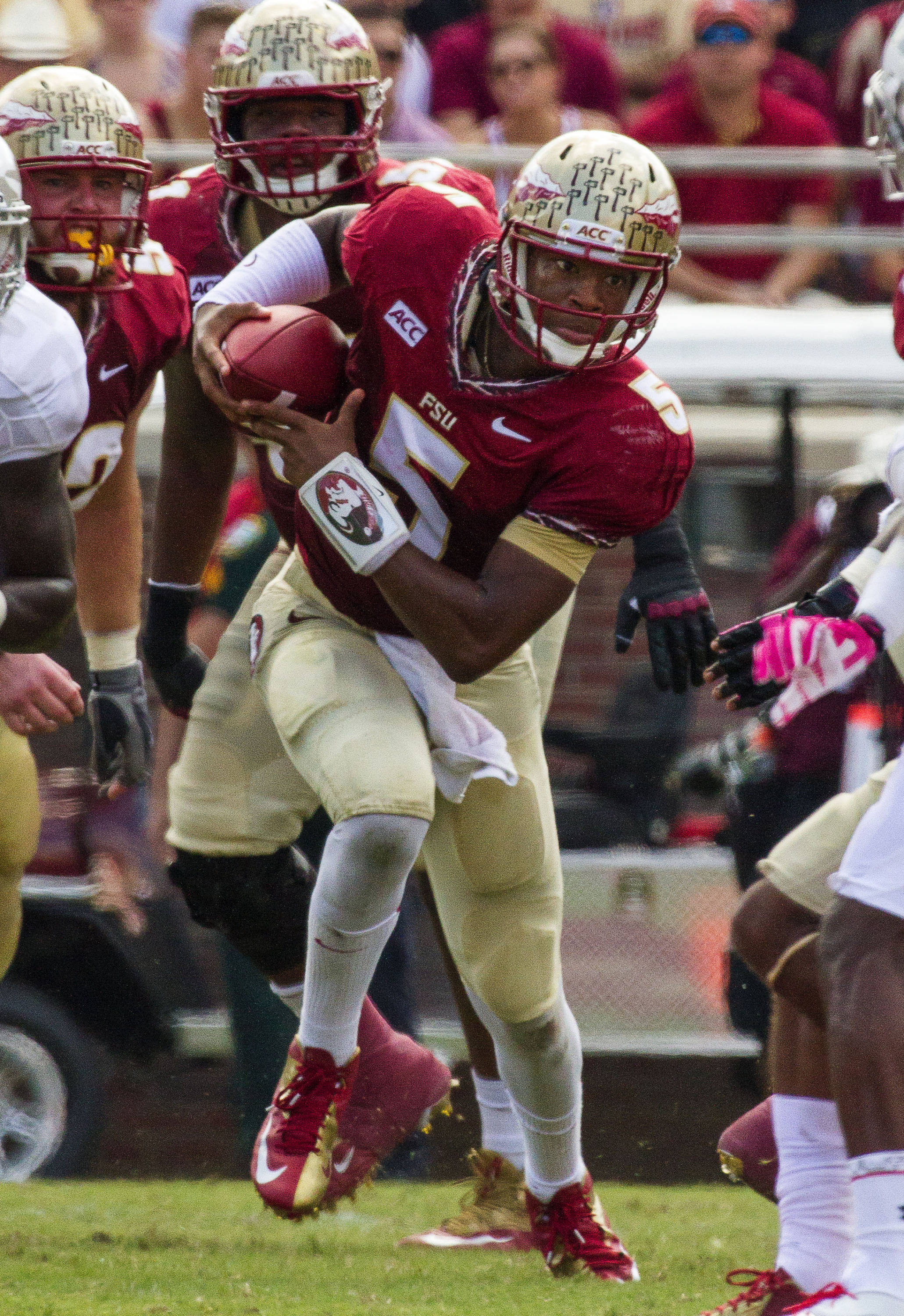 Jameis Winston (5) carries the ball during FSU Football's 63-0 shutout of Maryland on Saturday, October 5, 2013 in Tallahassee, Fla.