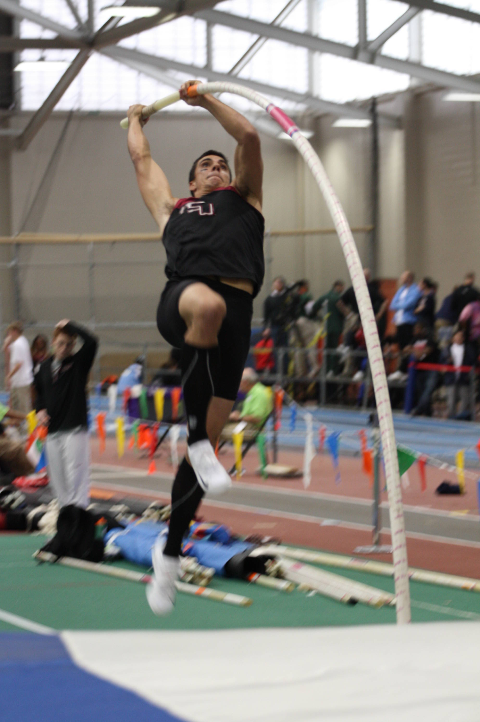 Gonzalo Barriolhet takes off on his way to a momentum-changing pole vault victory.