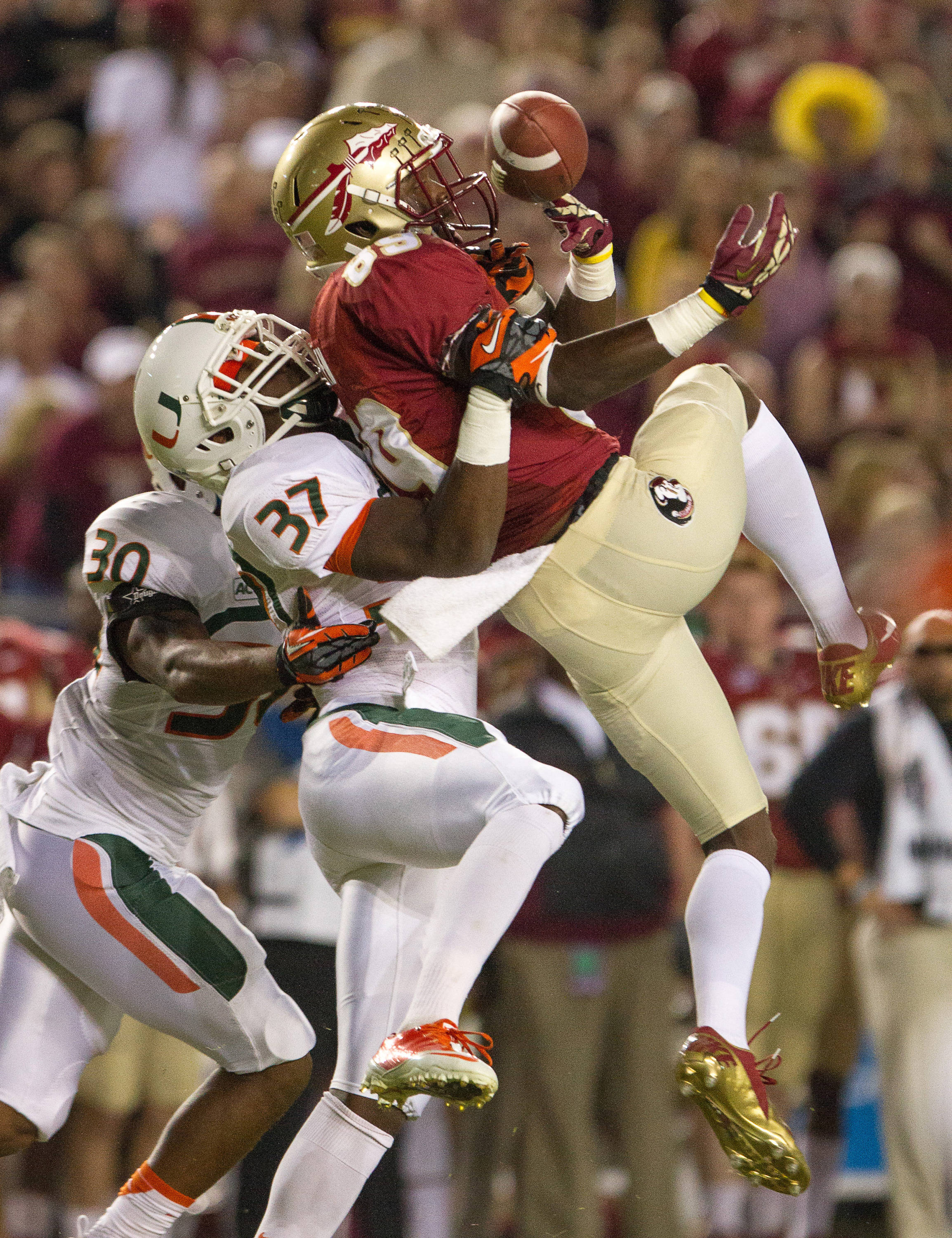 Christian Green (89) attempts to make a reception during FSU football's 41-14 win over Miami on Saturday, November 2, 2013 in Tallahassee, Fla. Photo by Michael Schwarz.