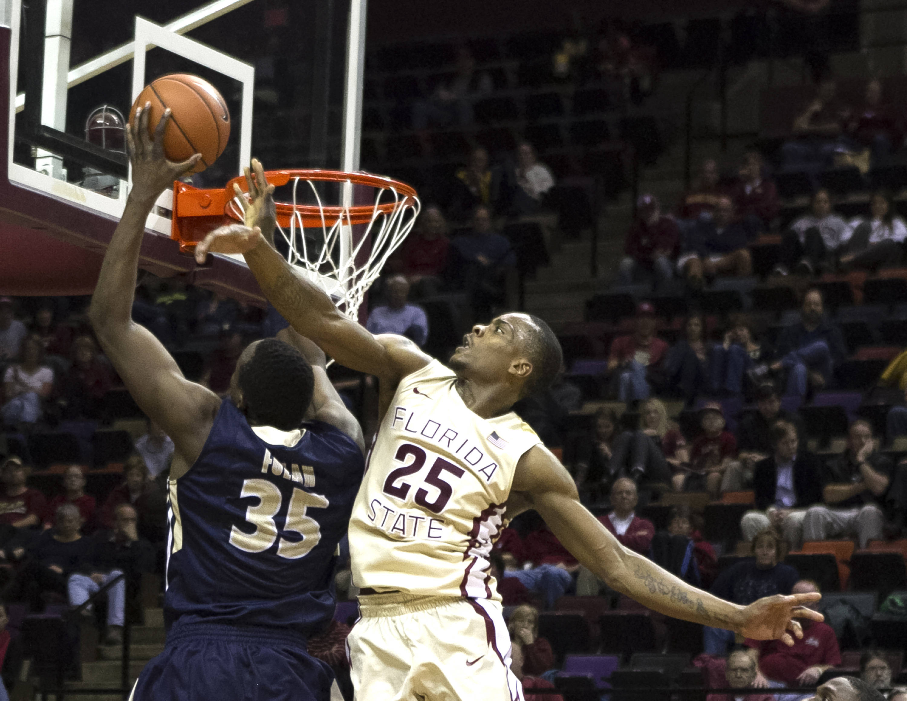 Aaron Thomas (25) challenging a shot, FSU vs Charleston Southern, 12-30-13,  (Photo by Steve Musco)