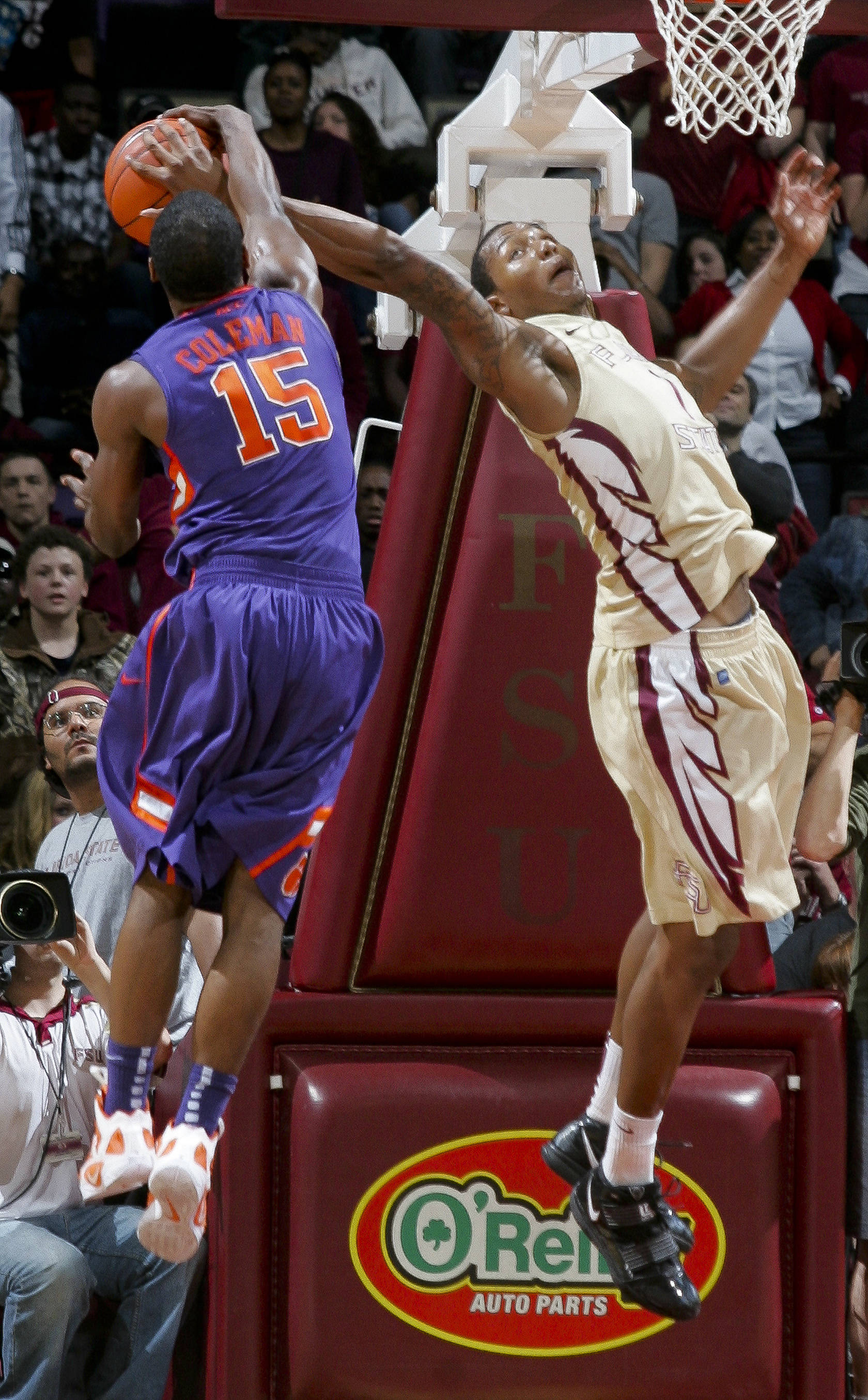 Clemson's Devin Coleman (15) attempts to strip Florida State's Xavier Gibson (1) of a rebound during the second half. (AP Photo/Phil Sears)