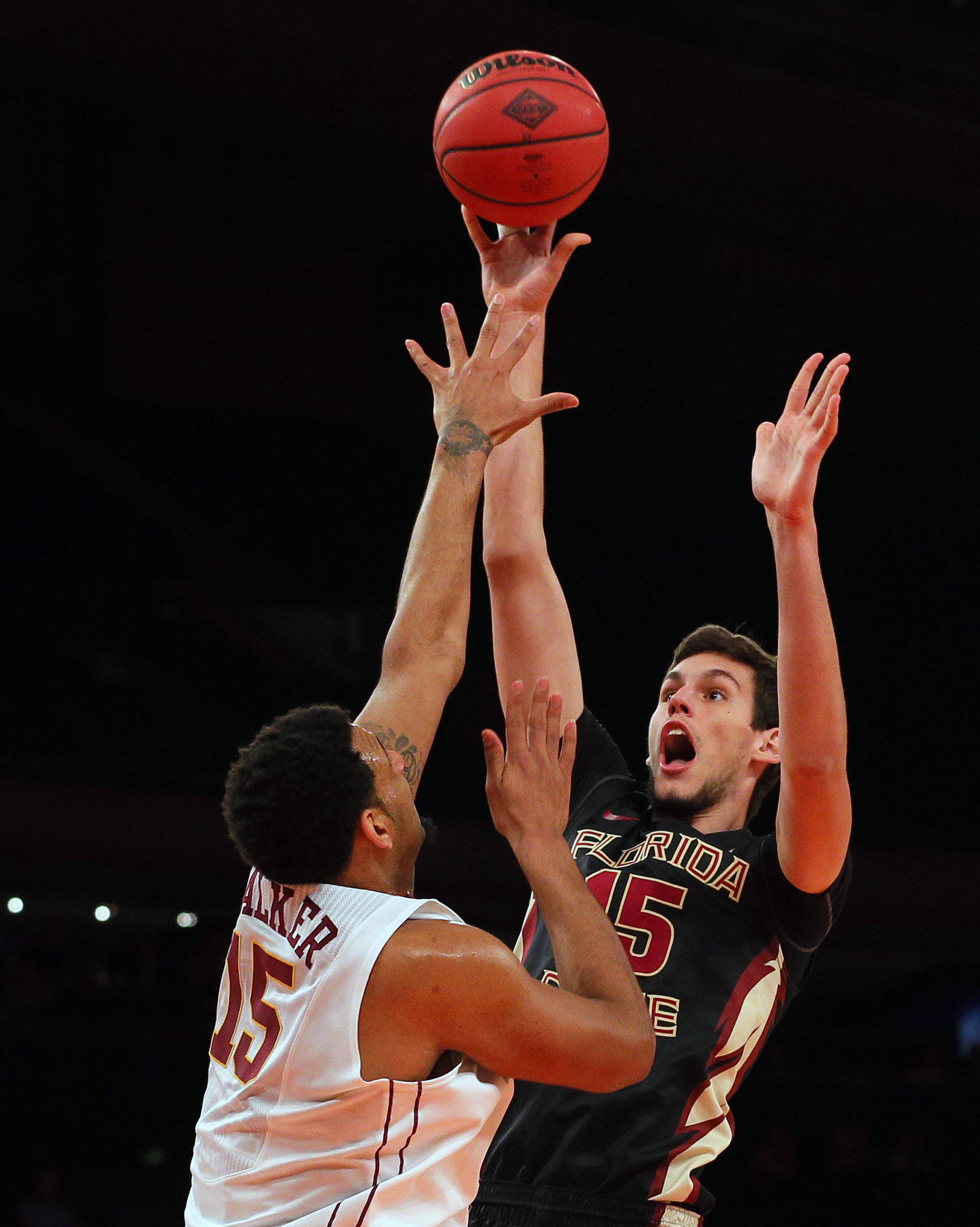 Apr 1, 2014; New York, NY, USA; Florida State Seminoles center Boris Bojanovsky (15) shoots over Minnesota Golden Gophers forward Maurice Walker (15) during the first half at Madison Square Garden. Mandatory Credit: Adam Hunger-USA TODAY Sports