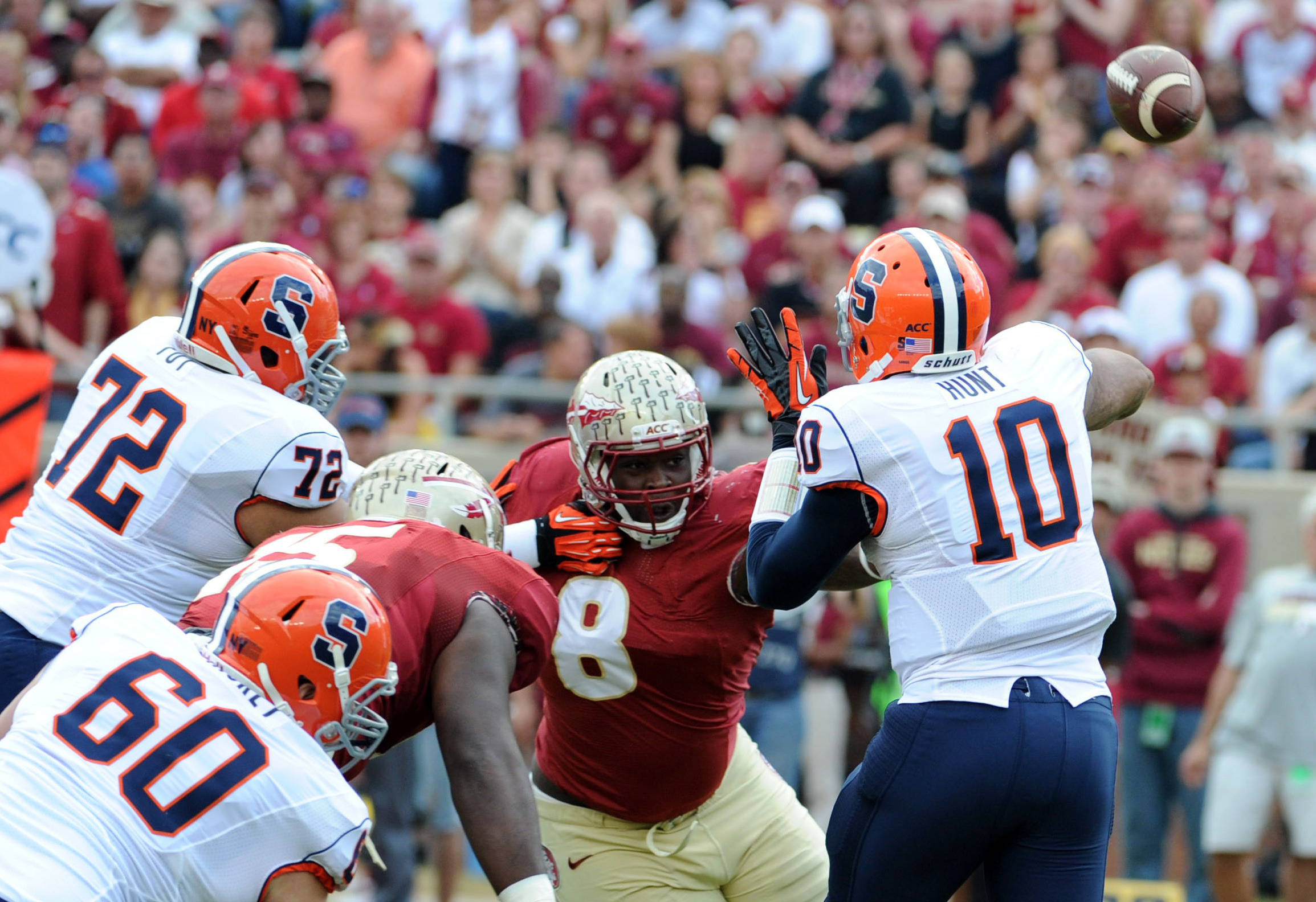 Terrel Hunt (10) throws the ball as he is pressured by Florida State Seminoles defensive tackle Timmy Jernigan (8). Mandatory Credit: Melina Vastola-USA TODAY Sports