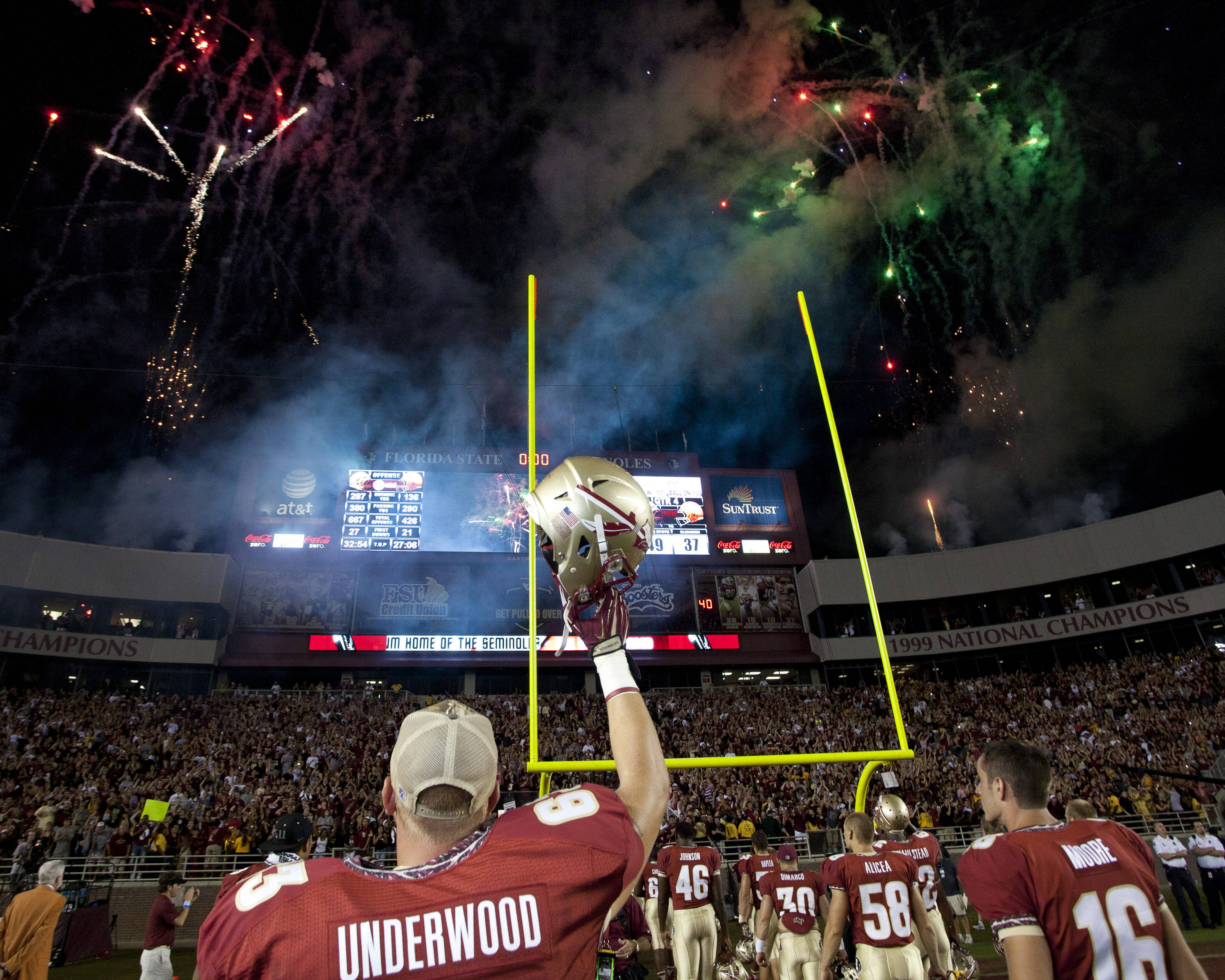 Chase Underwood (63) raises his helmet in the air after FSU's win.
