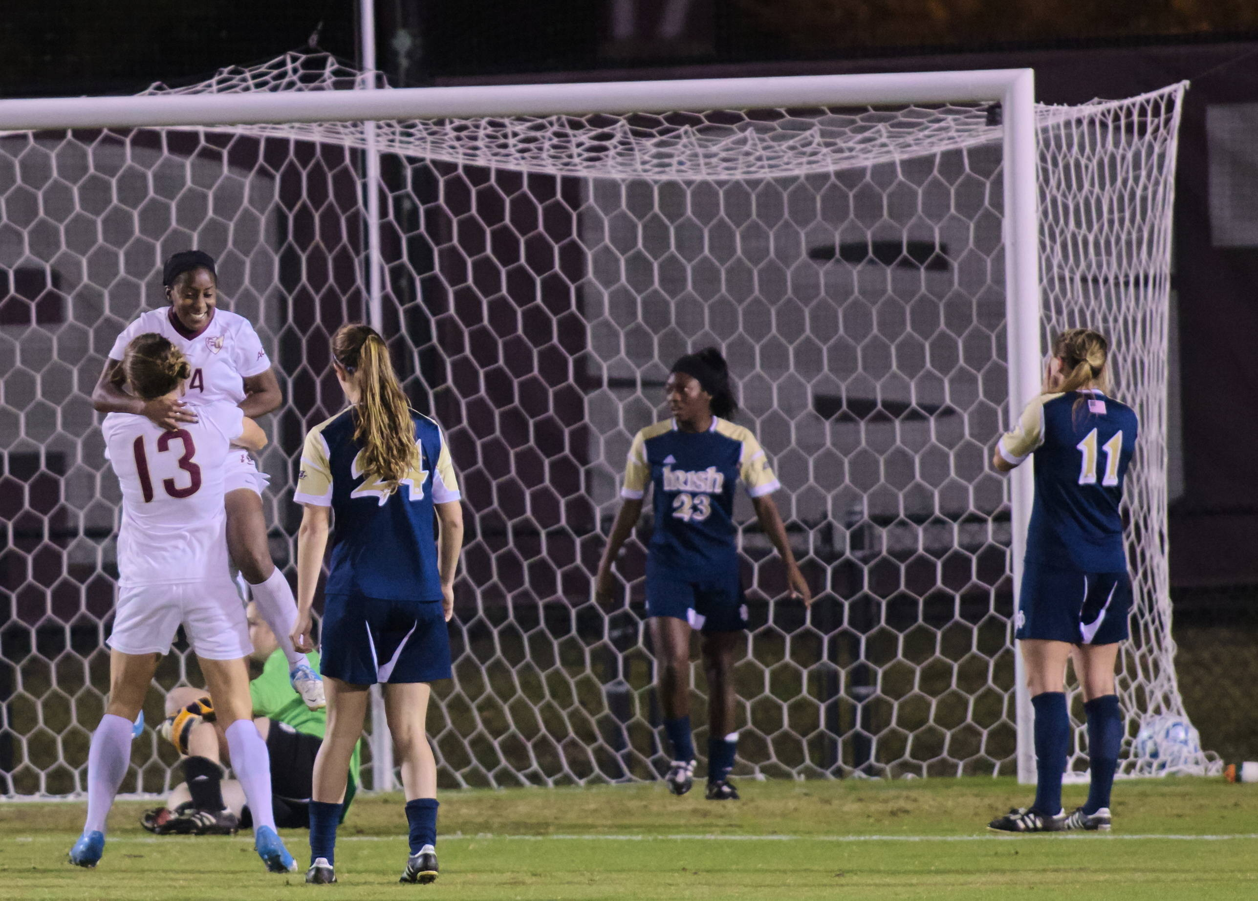 Kristin Grubka (13) lifting up Tiffany McCarty (14) after her eventual winning goal, FSU vs Notre Dame, 11/23/12. (Photo by Steve Musco)