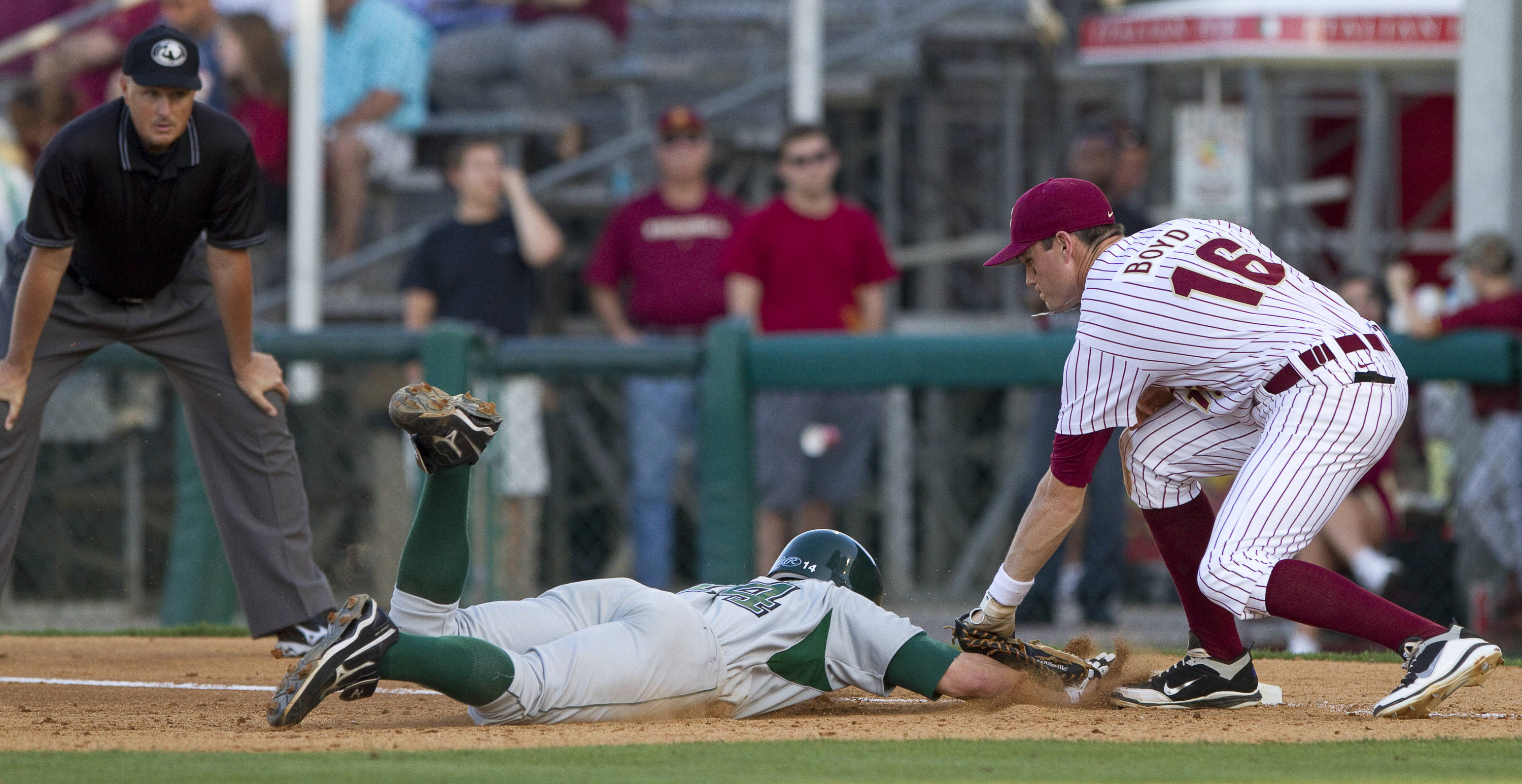 Jayce Boyd (16) tags out a runner from Stetson at first.