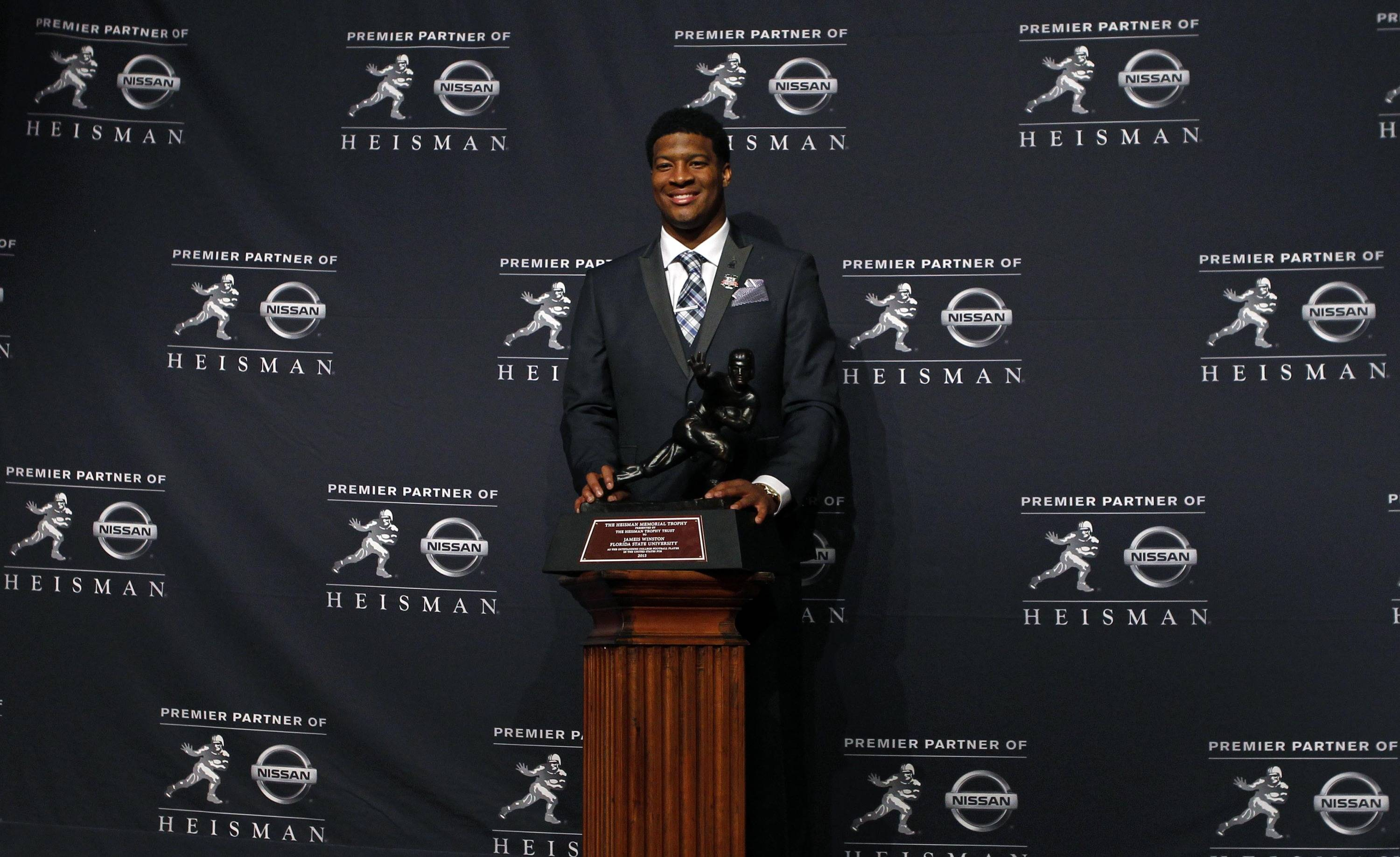 Dec 14, 2013; New York, NY, USA; Seminoles quarterback Jameis Winston poses for a photo. Adam Hunger-USA TODAY Sports