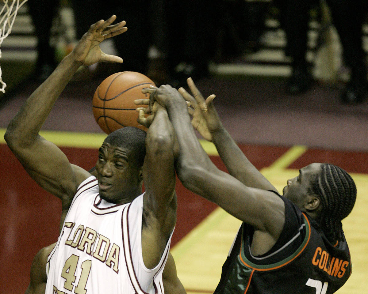 Florida State's Uche Echefu, left, and Miami's Dwayne Collins battle for a first-half rebound during a college basketball game Saturday, Jan. 20, 2007, in Tallahassee, Fla. (AP Photo/Phil Coale)