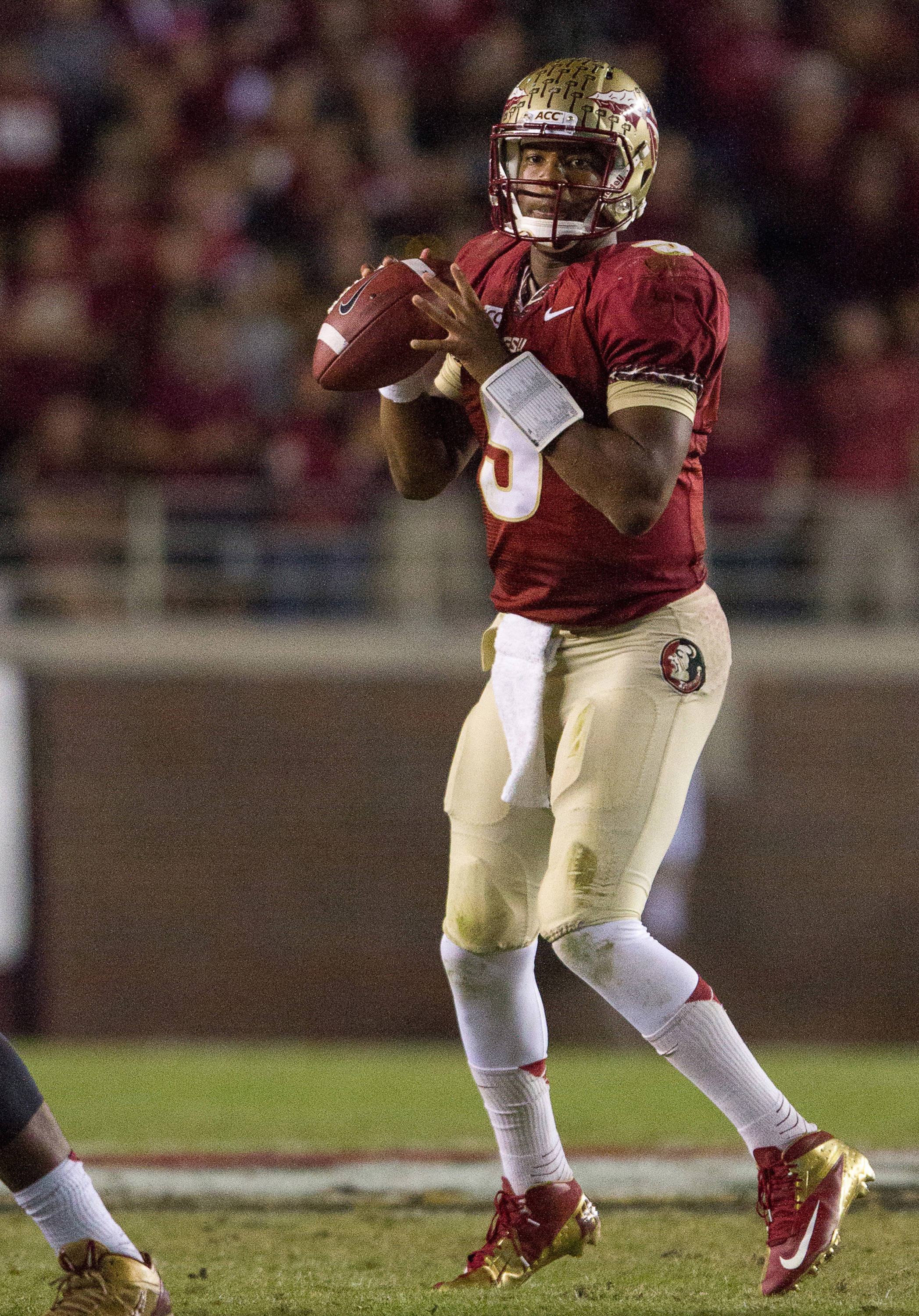 Jameis Winston (5) drops back to pass during FSU football's 41-14 win over Miami on Saturday, November 2, 2013 in Tallahassee, Fla. Photo by Michael Schwarz.