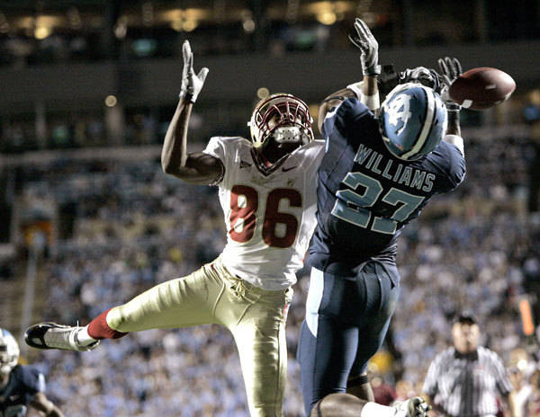 Florida State's Rod Owens (86) and North Carolina's Deunta Williams (27) battle for a pass during the second half.