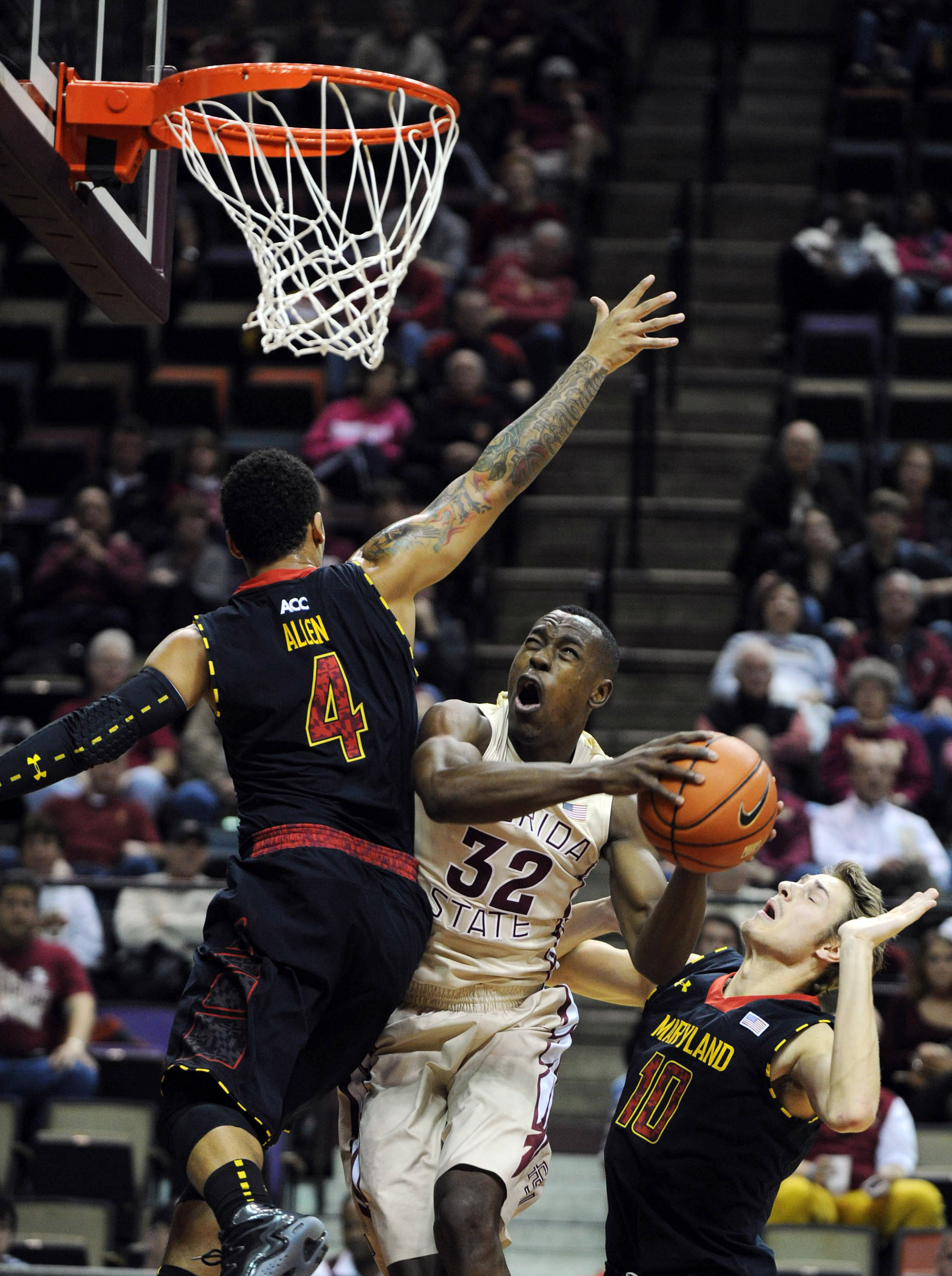 Jan 12, 2014; Tallahassee, FL, USA; Florida State Seminoles guard Montay Brandon (32) shoots the ball around Maryland Terrapins guard Seth Allen (4) during the first half at Donald L. Tucker Center. Mandatory Credit: Melina Vastola-USA TODAY Sports