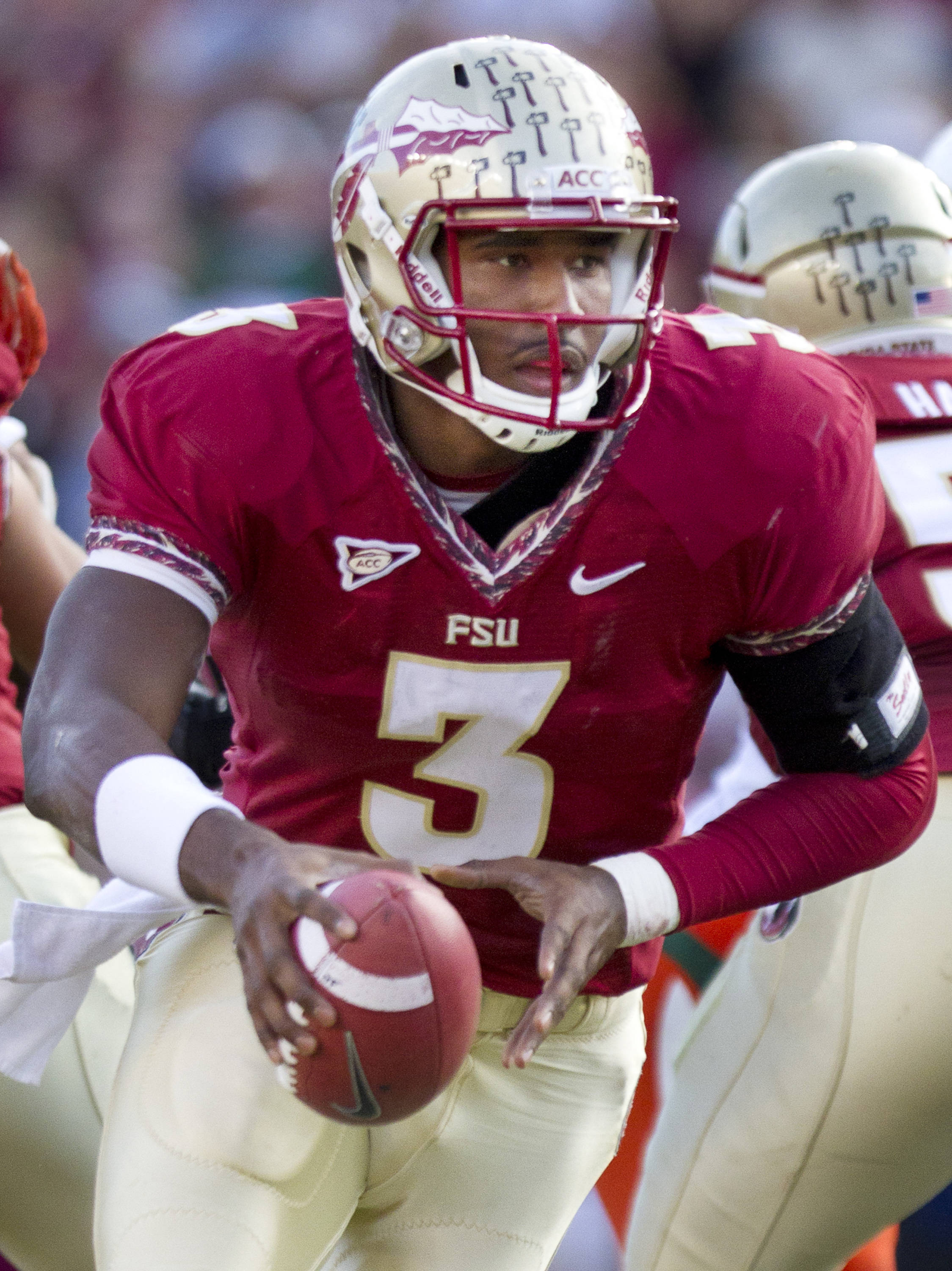 EJ Manuel (3) fakes a hand-off during the football game against Miami on November 12, 2011.