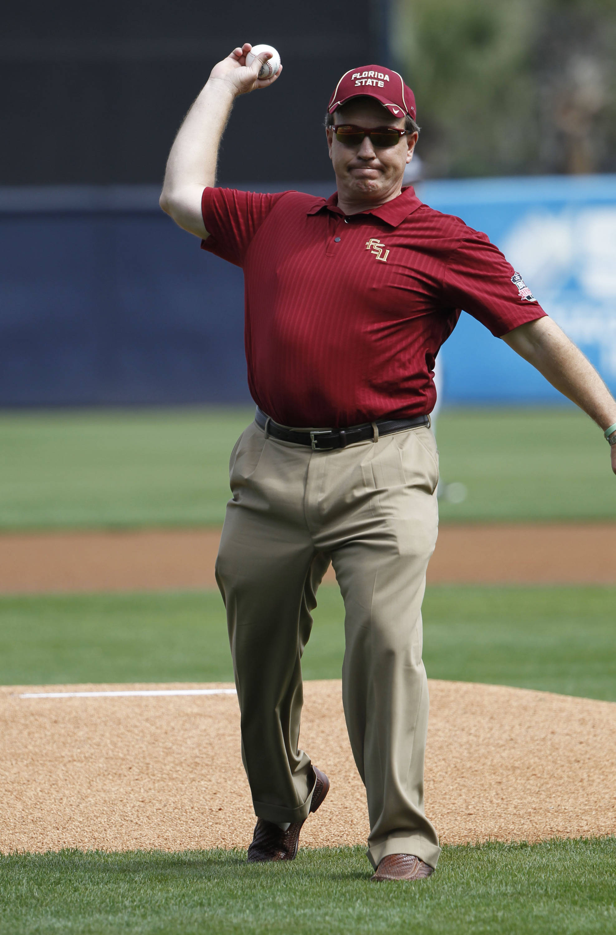 Feb 25, 2014; Tampa, FL, USA;  Florida State Seminoles football head coach Jimbo Fisher throws out the first pitch before the game against the New York Yankees at George M. Steinbrenner Field. Mandatory Credit: Kim Klement-USA TODAY Sports