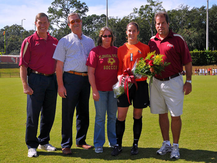Kimmy Diaz with her parents, head coach Mark Krikorian and Athletics Director Randy Spetman