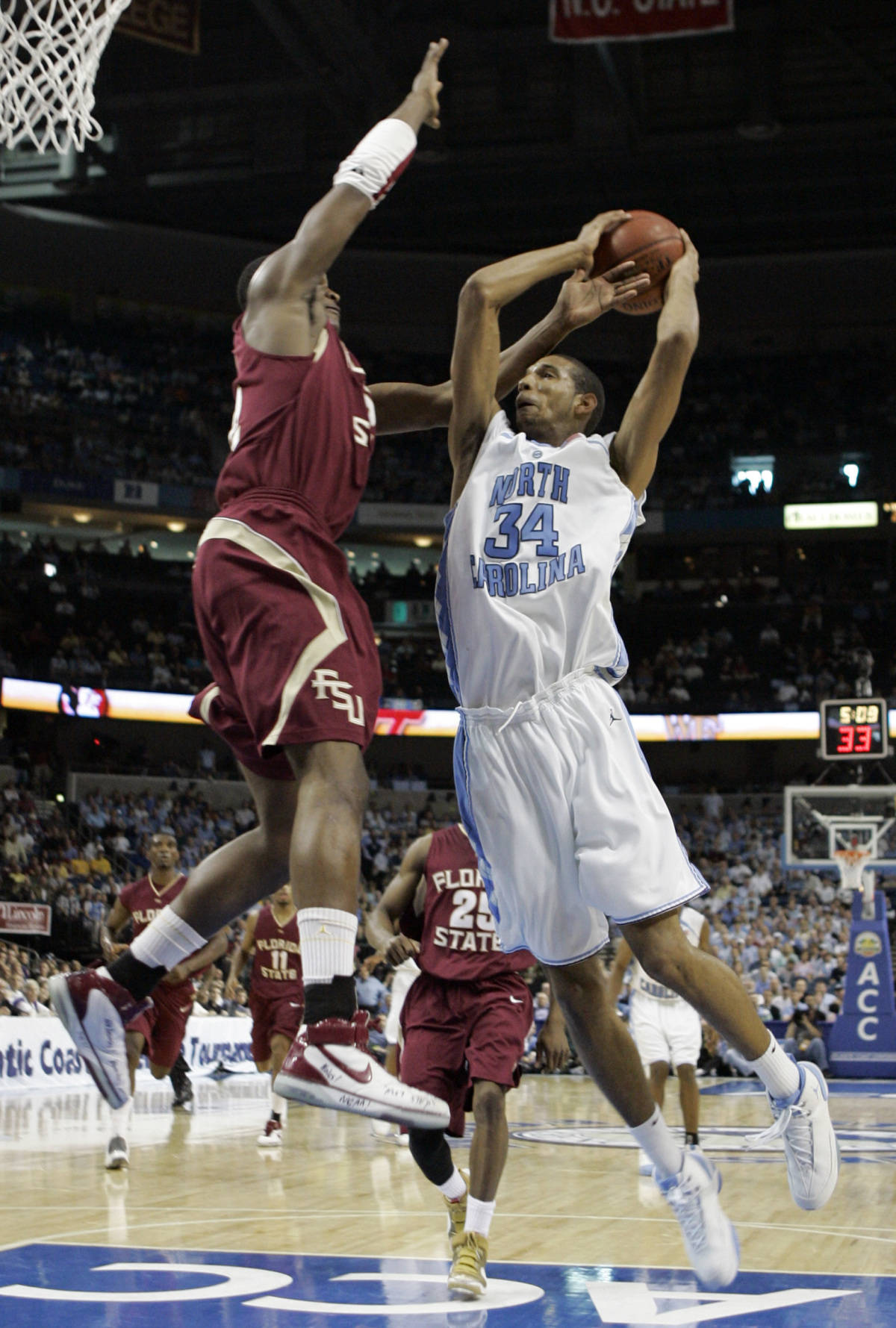 Florida State's Al Thornton, left, leaps to block a shot by North Carolina's Brandan Wright (34) second round game of the Men's Atlantic Coast Conference basketball tournament in Tampa, Fla., Friday, March 9, 2007. (AP Photo/David J. Phillip)