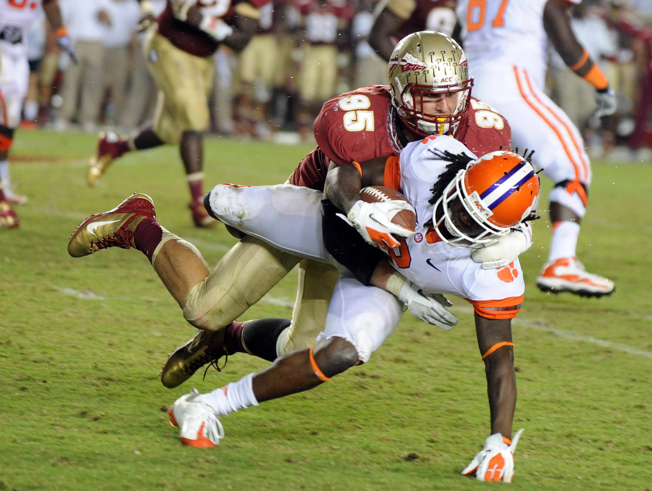 Sept 22, 2012;  Tallahassee, Florida, USA; Florida State Seminoles defensive end Bjoern Werner (95) tackles Clemson Tigers wide receiver Sammy Watkins (2) during the second half of the game at Doak Campbell Stadium. Mandatory Credit: Melina Vastola-USA TODAY Sports