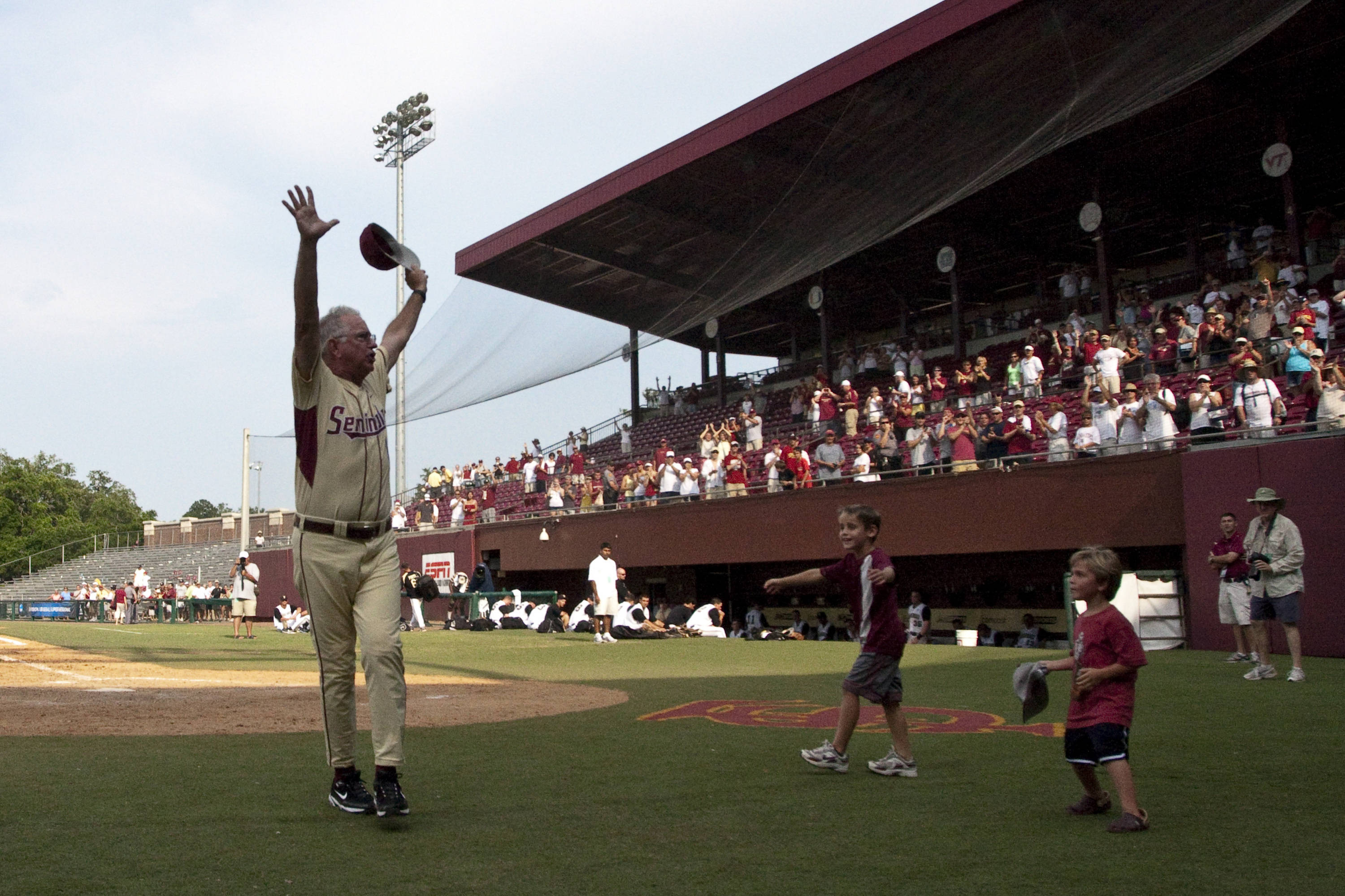 Mike Martin (11) waves to a cheering crowd after thanking them for their support.