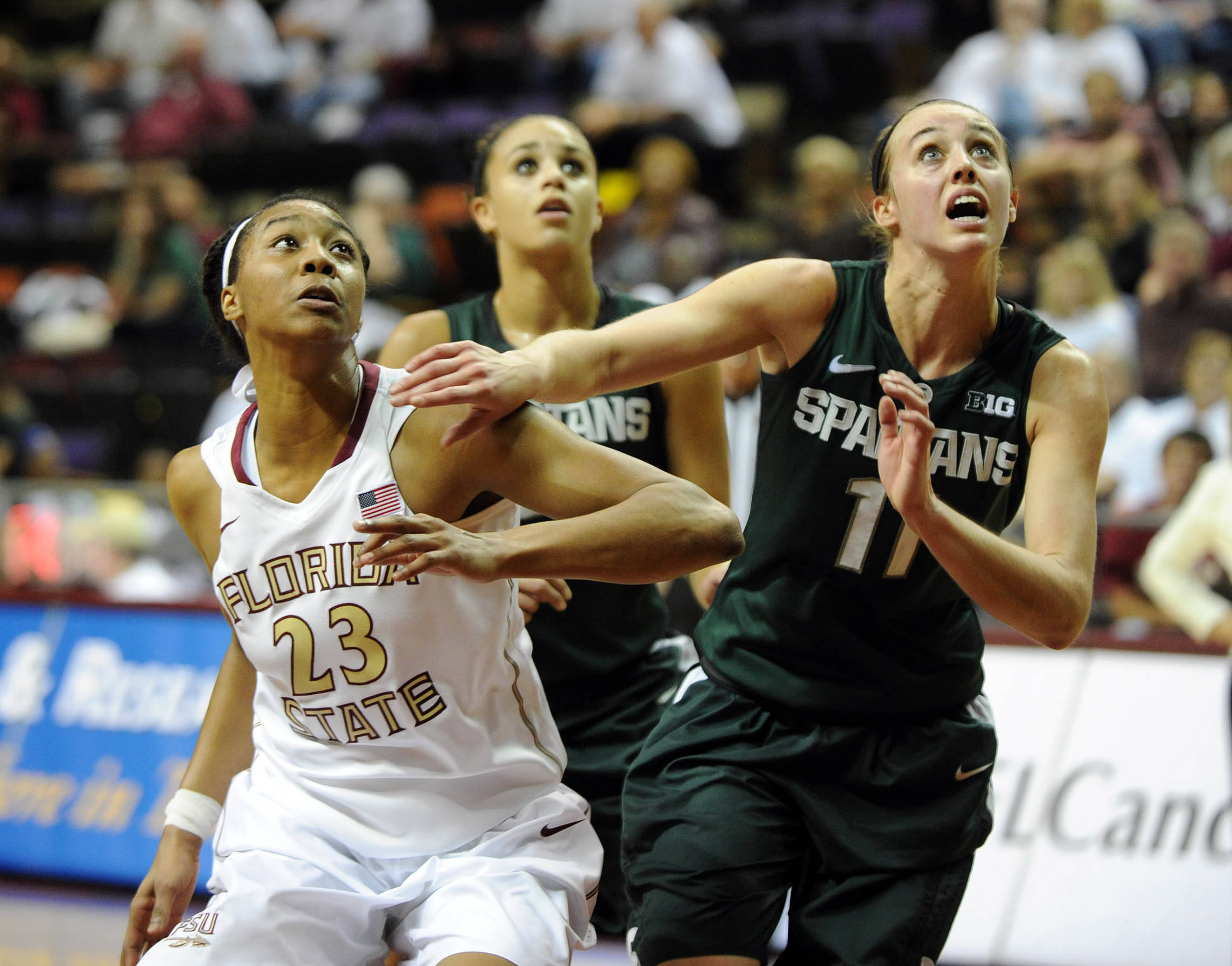 Dec 4, 2013; Tallahassee, FL, USA; Michigan State forward Annalise Pickrel (11) rights for position against Florida State Seminoles forward Ivey Slaughter (23) during the game at the Donald L. Tucker Center (Tallahassee). Mandatory Credit: Melina Vastola-USA TODAY Sports