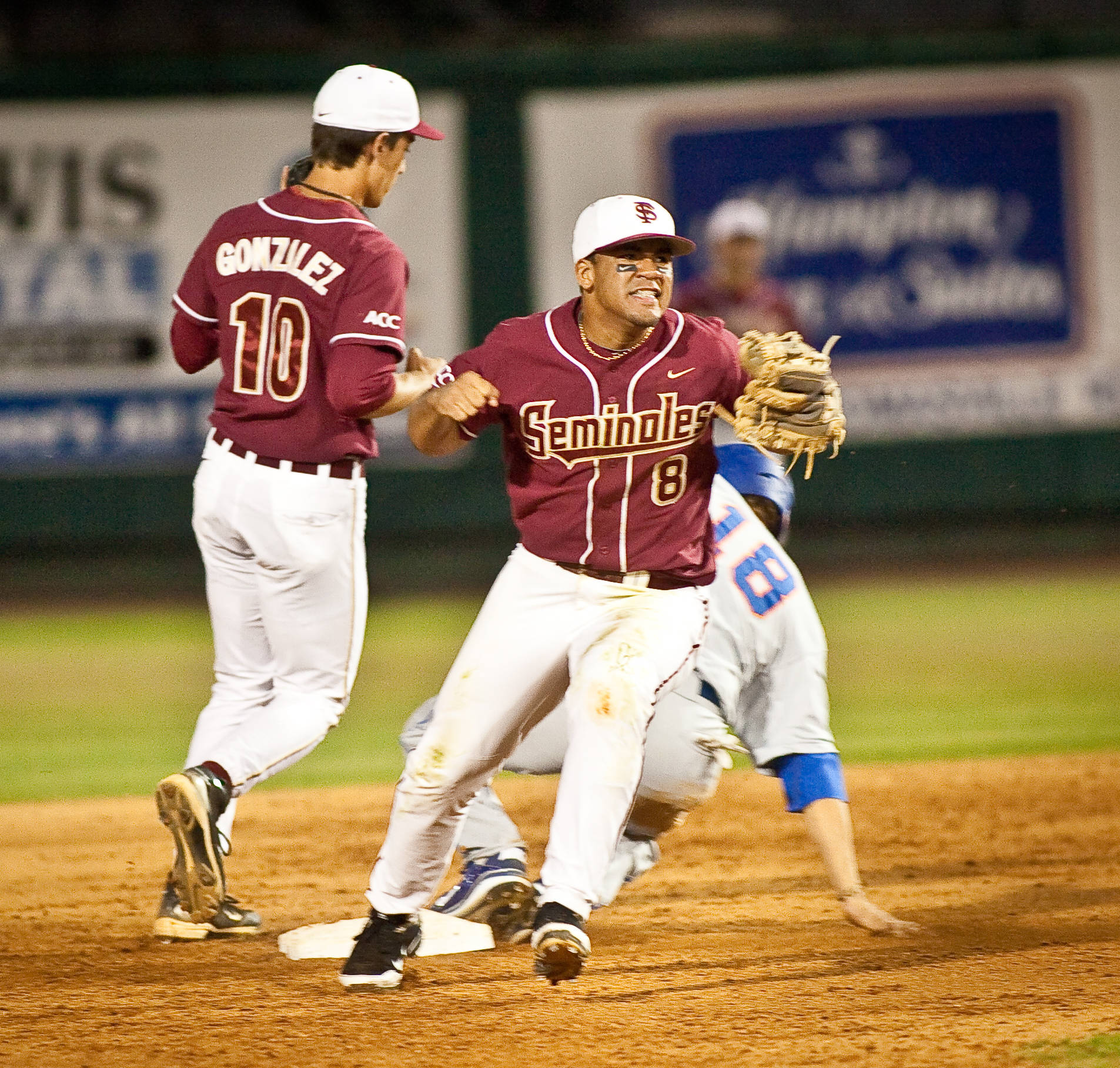 Devon Travis (8) celebrates the final out