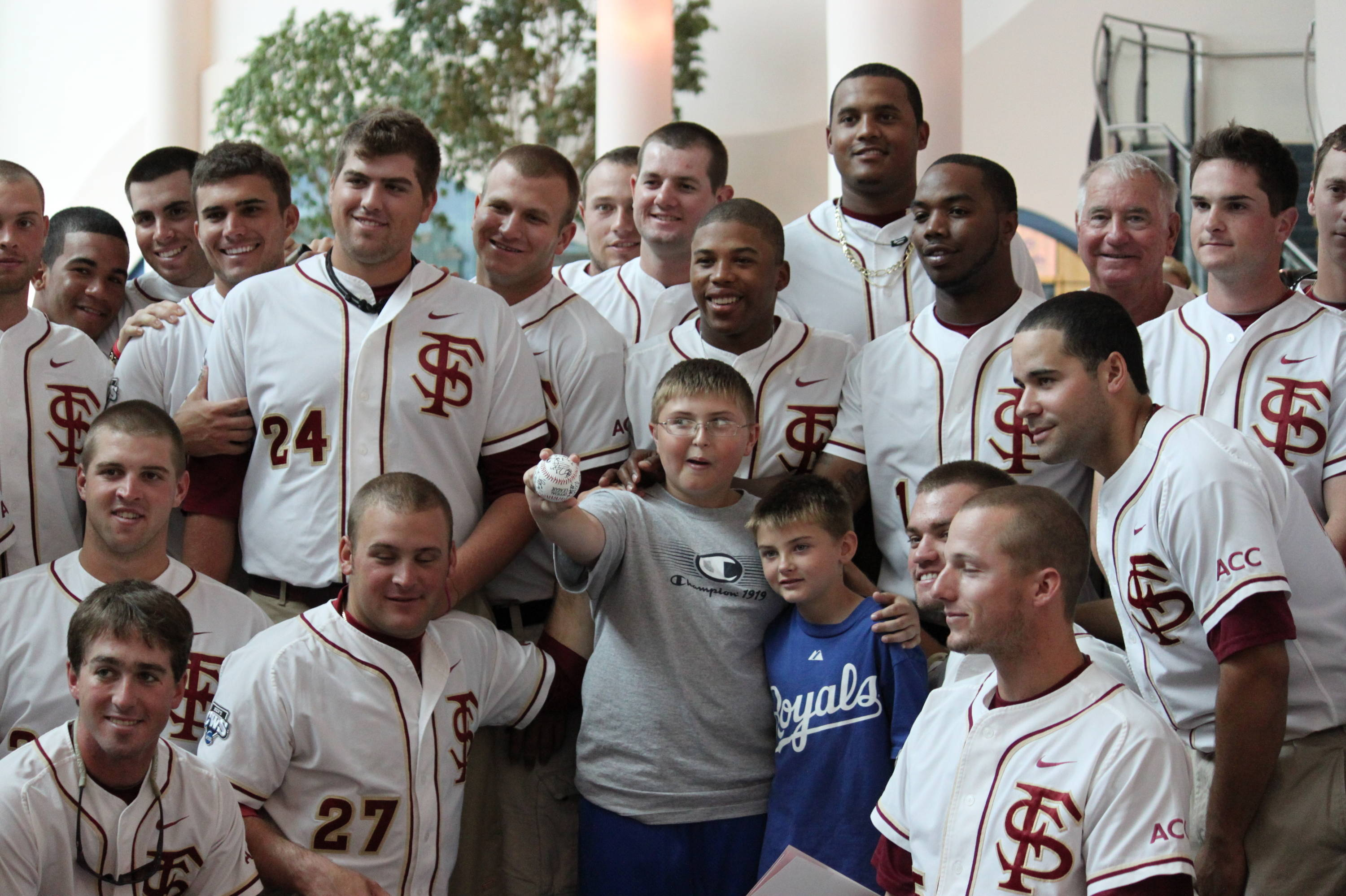 The 2010 Seminole baseball team pose for a photo with some of the children during their visit to the hospital.