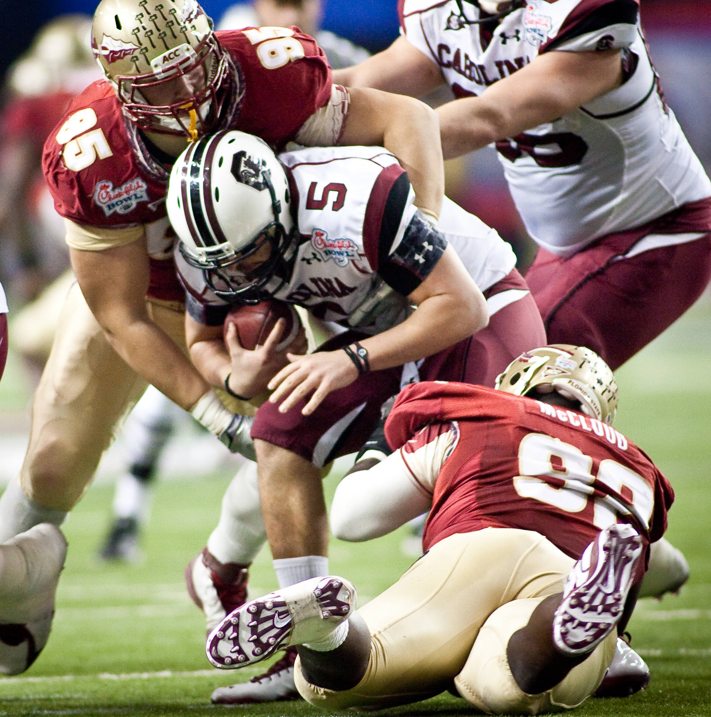 Bjoern Werner (95), Anthony McCloud (92) sack South Carolina QB Stephen Garcia