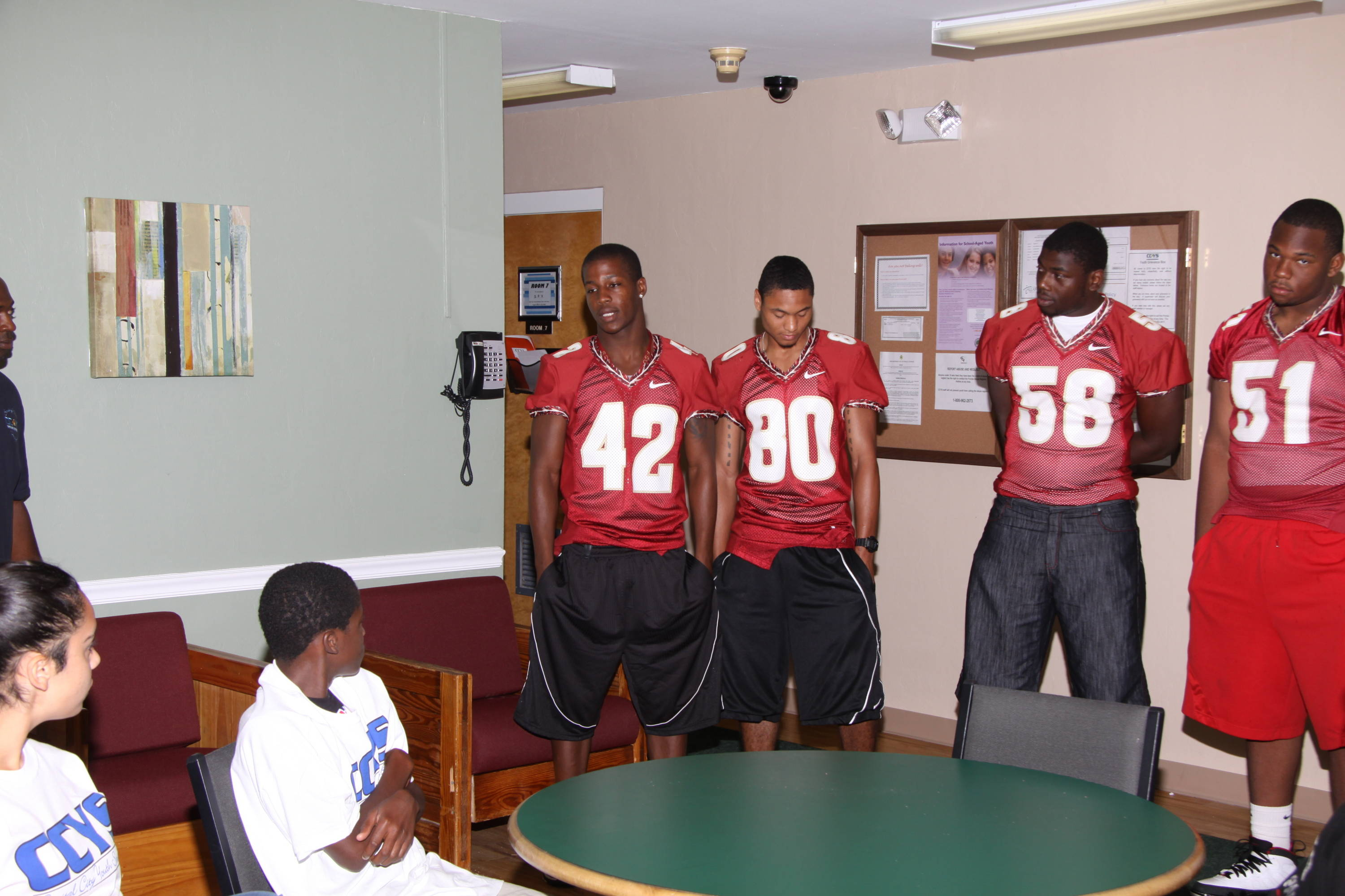 Players talk to teens at Capital City Youth Services.