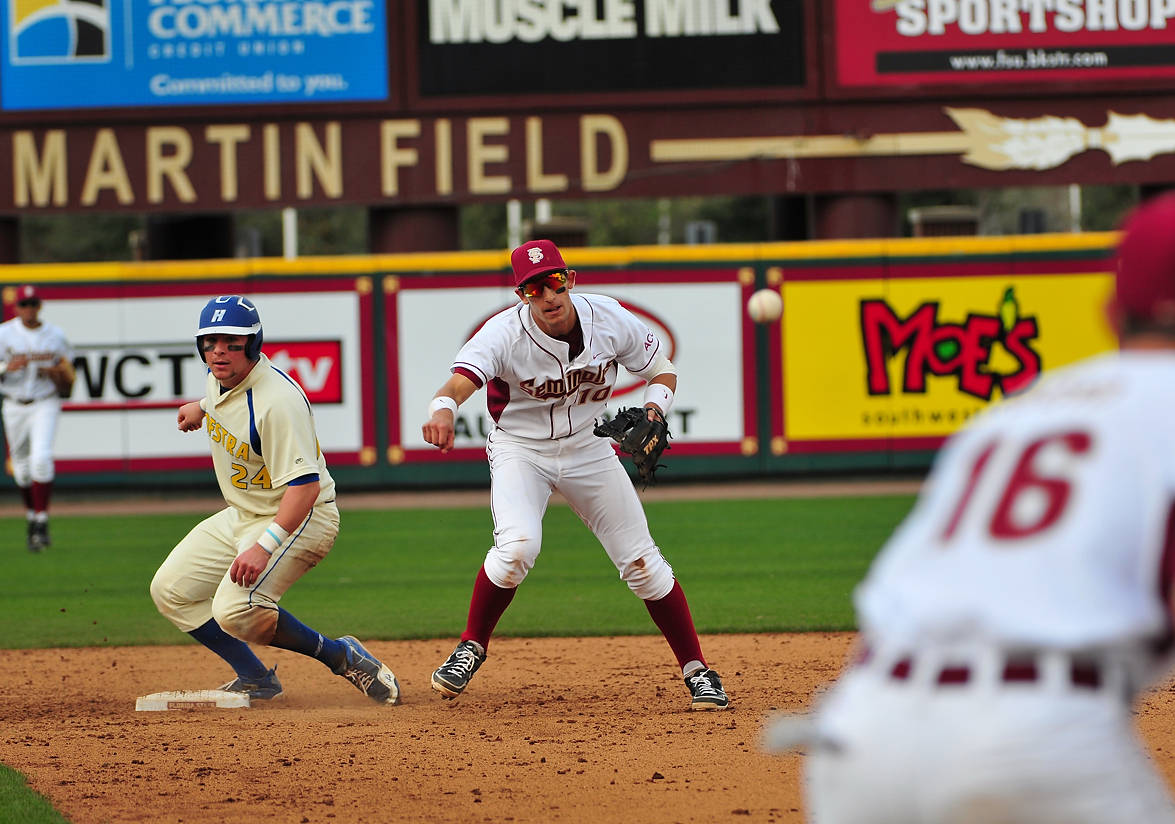 Justin Gonzalez throws over to Jayce Boyd at first to complete the double play.
