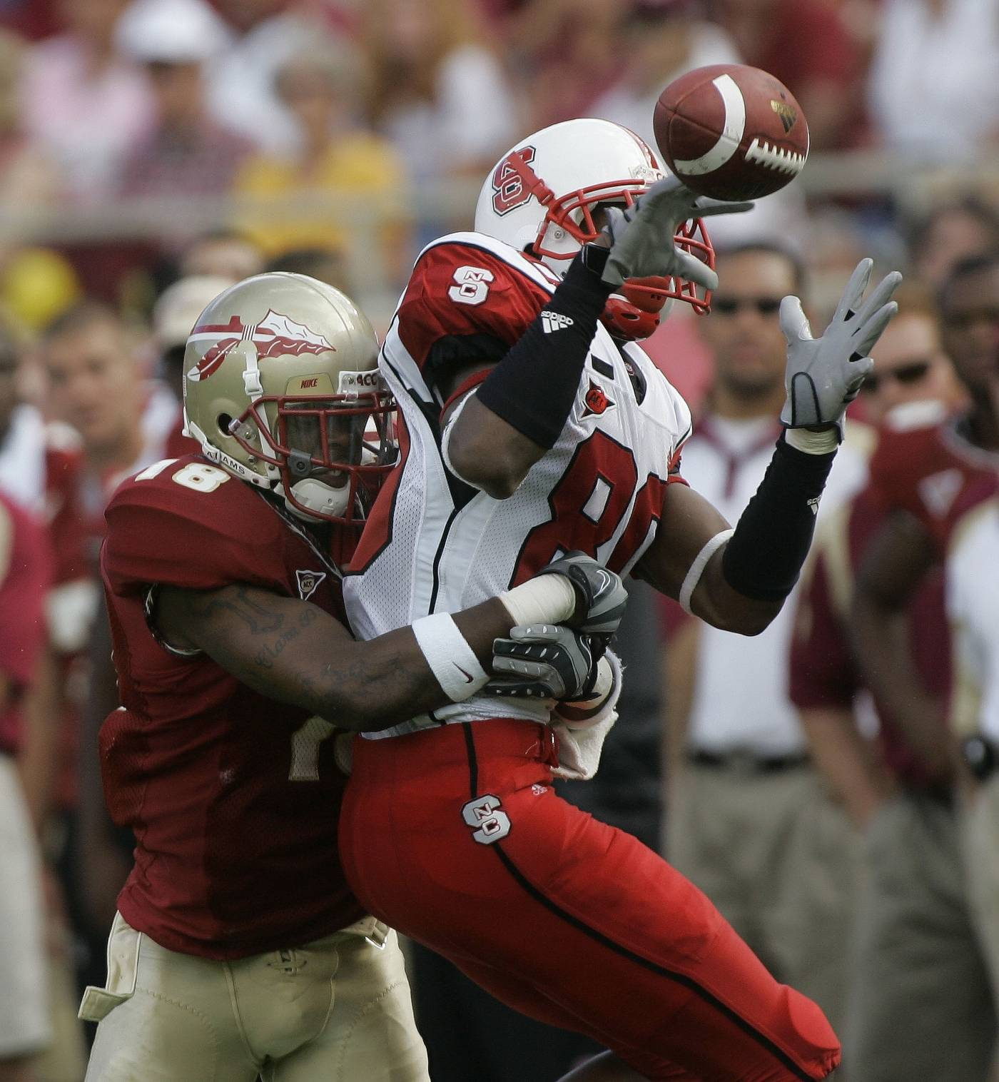 Florida State defensive back J. R. Bryant, left, is called for pass interference as he attempts to defend North Carolina State receiver Donald Bowens. (AP Photo/Phil Coale)