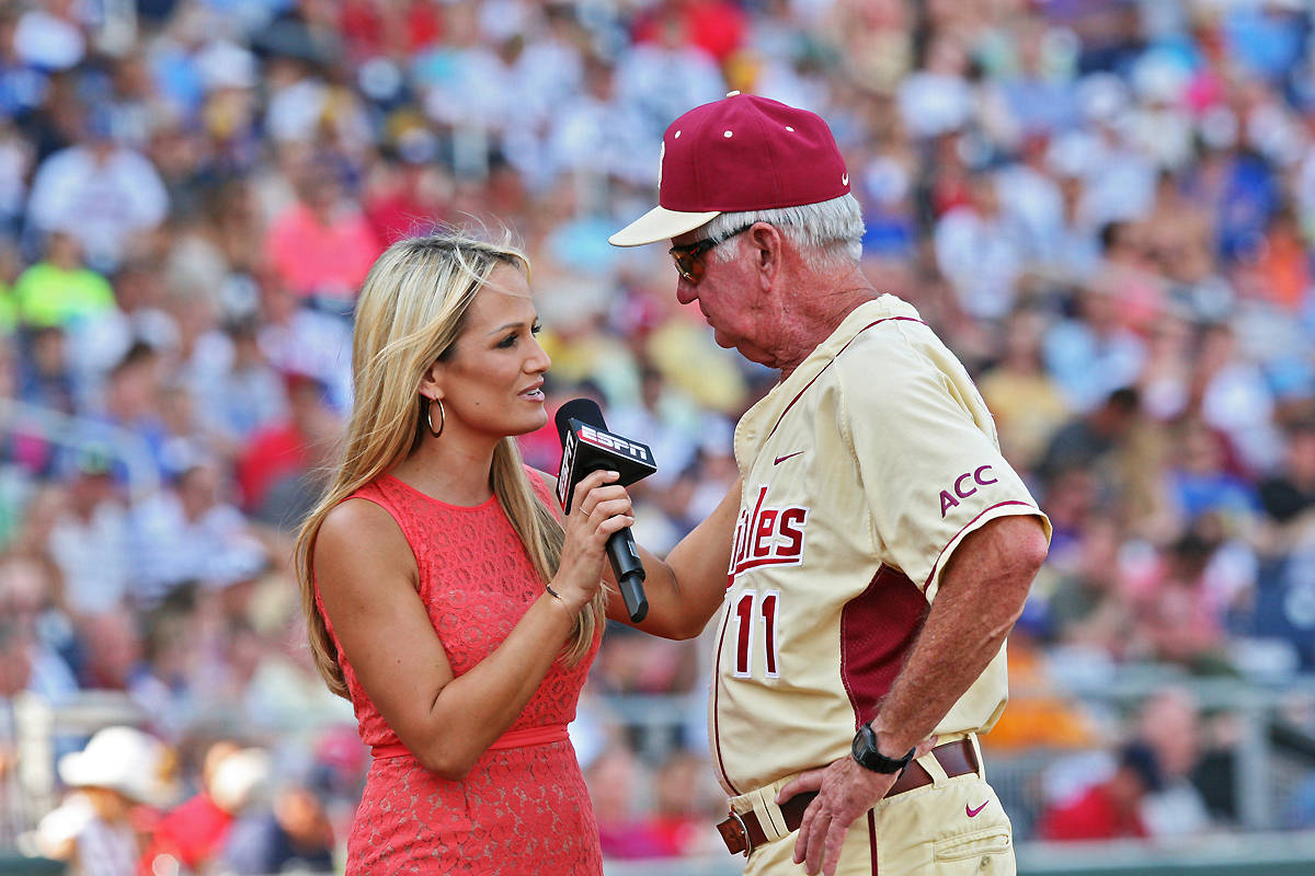ESPN's Jenn Brown talks to head coach Mike Martin in the middle of the fifth inning.