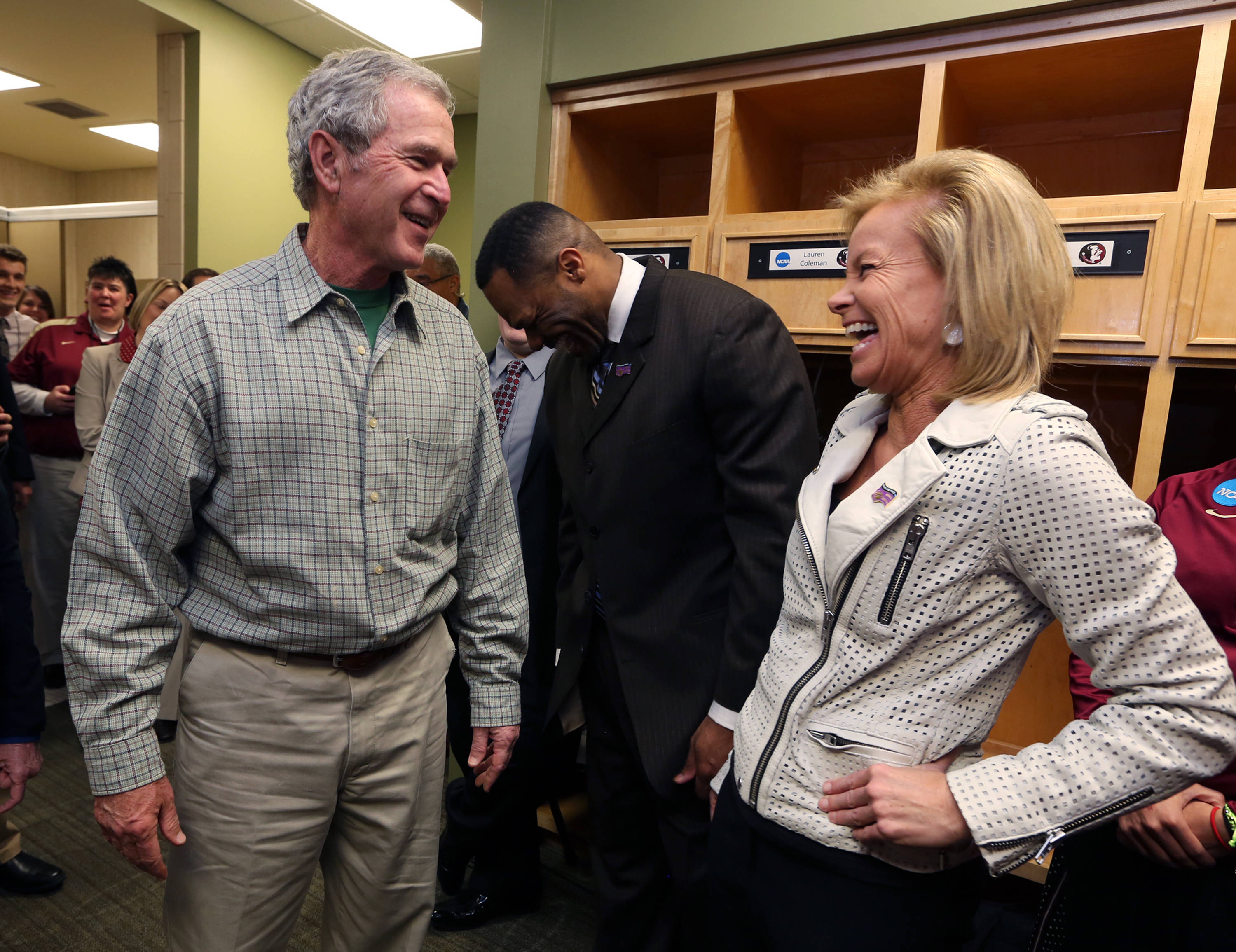Former President George W. Bush laughs with Florida State head coach Sue Semrau, right, before their second-round game against Baylor in the NCAA women's college basketball tournament, Tuesday, March, 26, 2013, in Waco, Texas. (AP Photo/Rod Aydelotte, Pool)