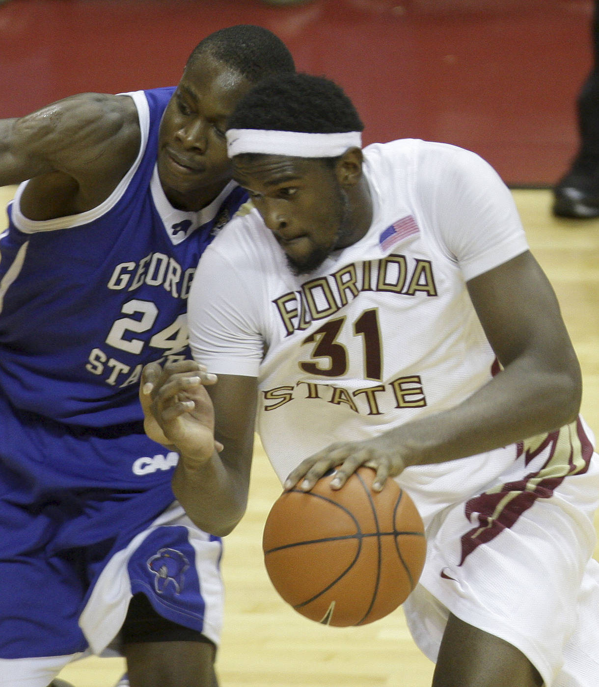 Florida State's Chris Singleton, right, drives past Georgia State's Ousman Krubally during the second half of an NCAA college basketball game, on Tuesday, Dec. 15, 2009, in Tallahassee, Fla.  Florida State won 62-55.(AP Photo/Phil Coale)