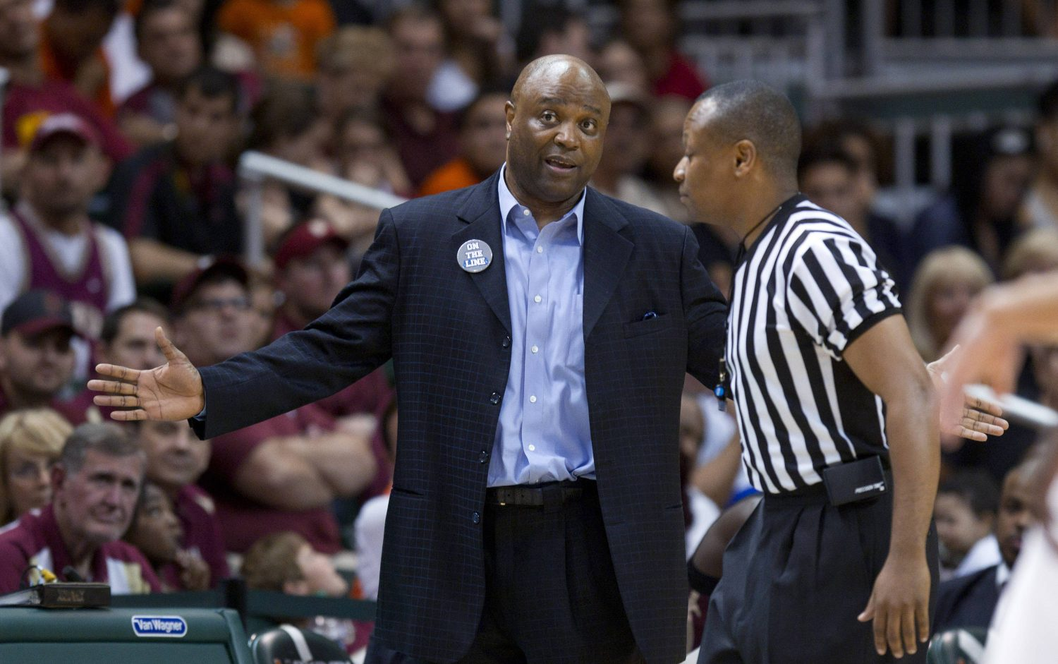 Florida State coach Leonard Hamilton argues a foul call with an official during the second half of an NCAA college basketball game in Coral Gables, Fla., Sunday, Feb. 26, 2012, against Miami. Miami defeated Florida State 78-62. (AP Photo/J Pat Carter)