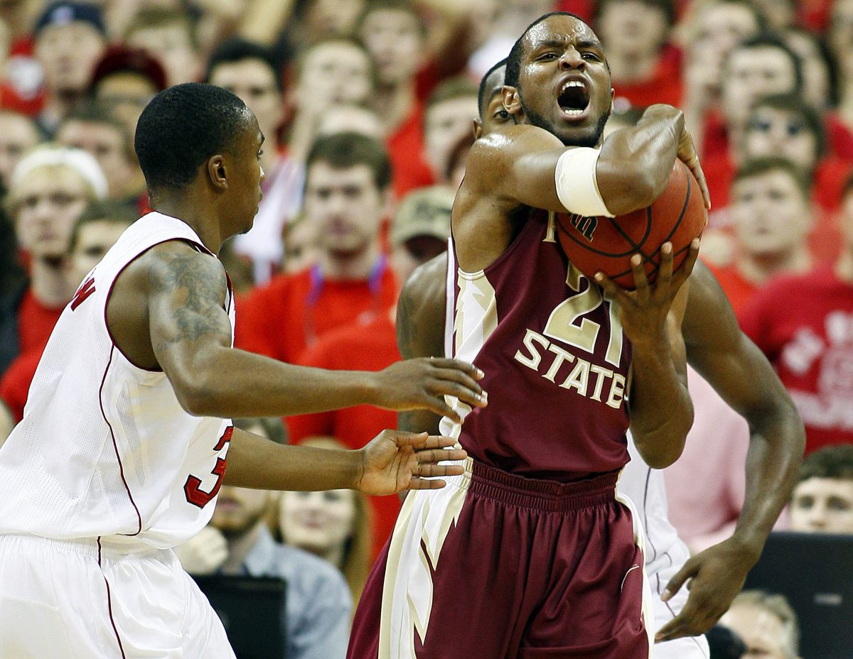 Florida State's Michael Snaer (21) reacts after ripping the ball away from North Carolina State's Alex Johnson (3) during the second half of an NCAA college basketball game in Raleigh, N.C., Saturday, Feb. 18, 2012. Snaer had 10 points in Florida State's 76-62 win.(AP Photo/Karl B DeBlaker)