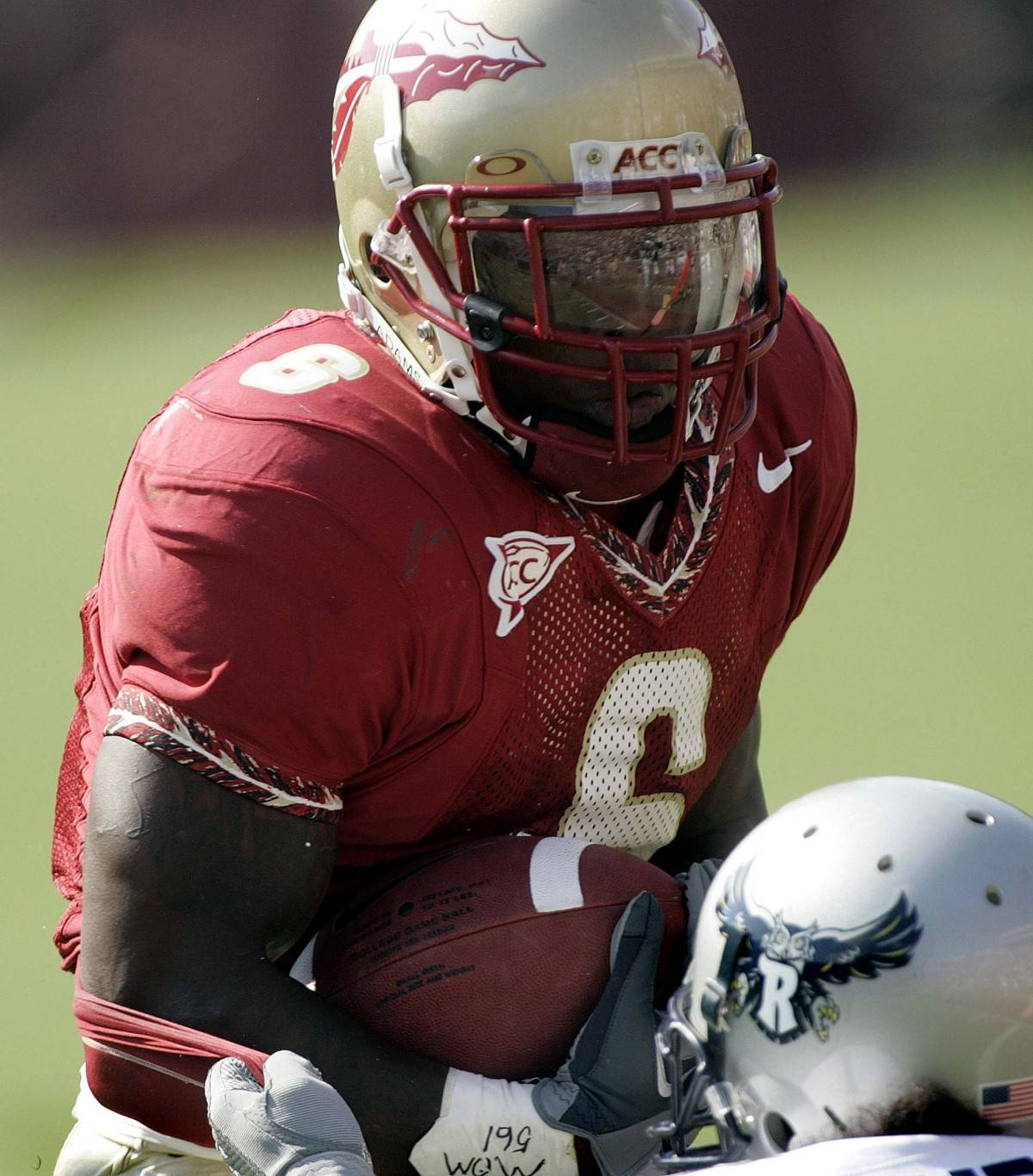 Florida State running back Antone Smith makes a first-quarter run as Rice's Gary Anderson, Jr., bottom, prepares to make the stop during an NCAA football game, Saturday, Sept. 23, 2006, in Tallahassee, Fla.(AP Photo/Phil Coale)