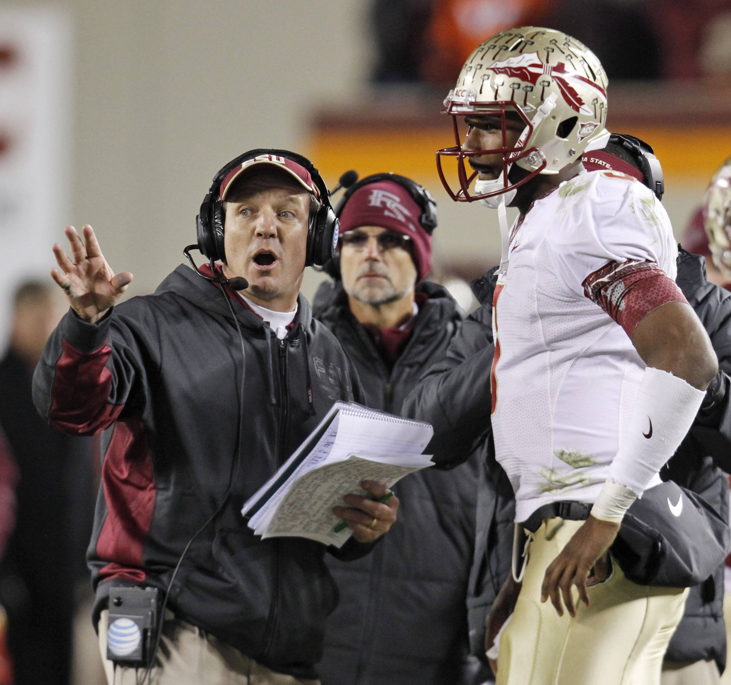 Florida State coach Jimbo Fisher, left, talks with quarterback EJ Manuel. (AP Photo/Steve Helber)