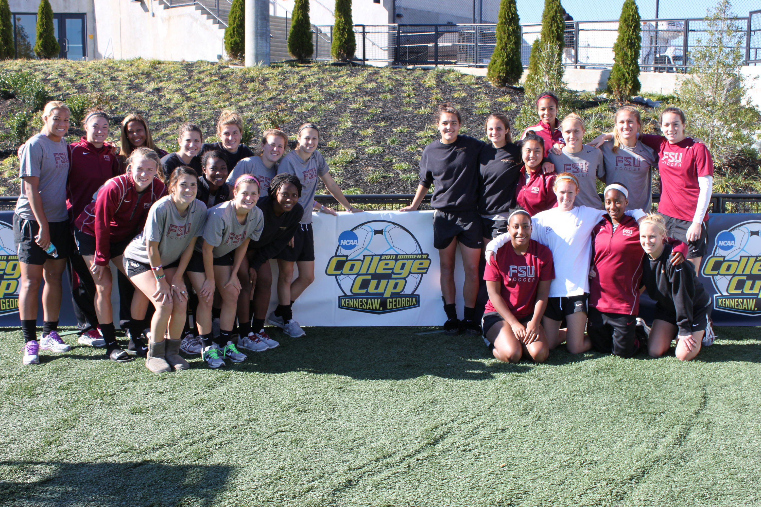 The team finds a shot with the College Cup logo.
