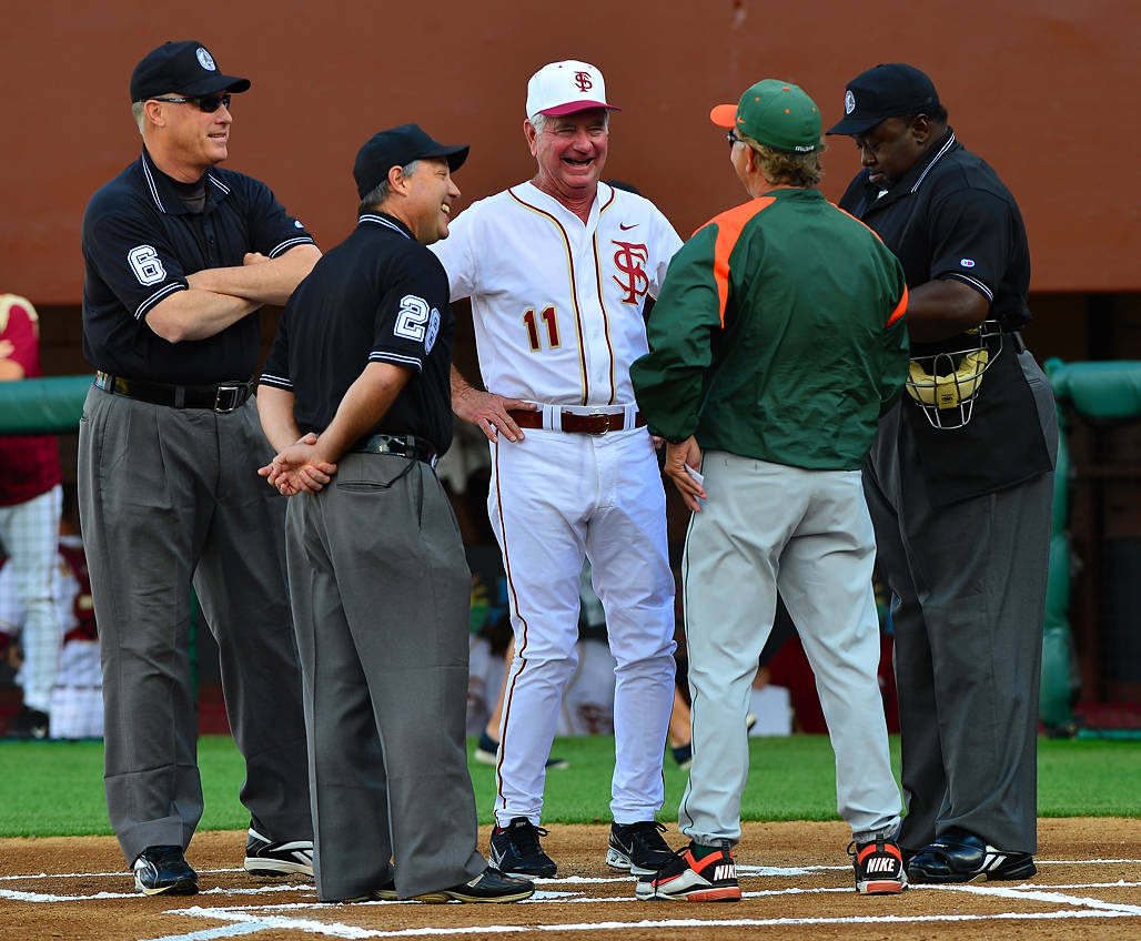 FSU head coach Mike Martin and Miami head coach Jim Morris meet at home plate with the umpires before the start of Friday's game.