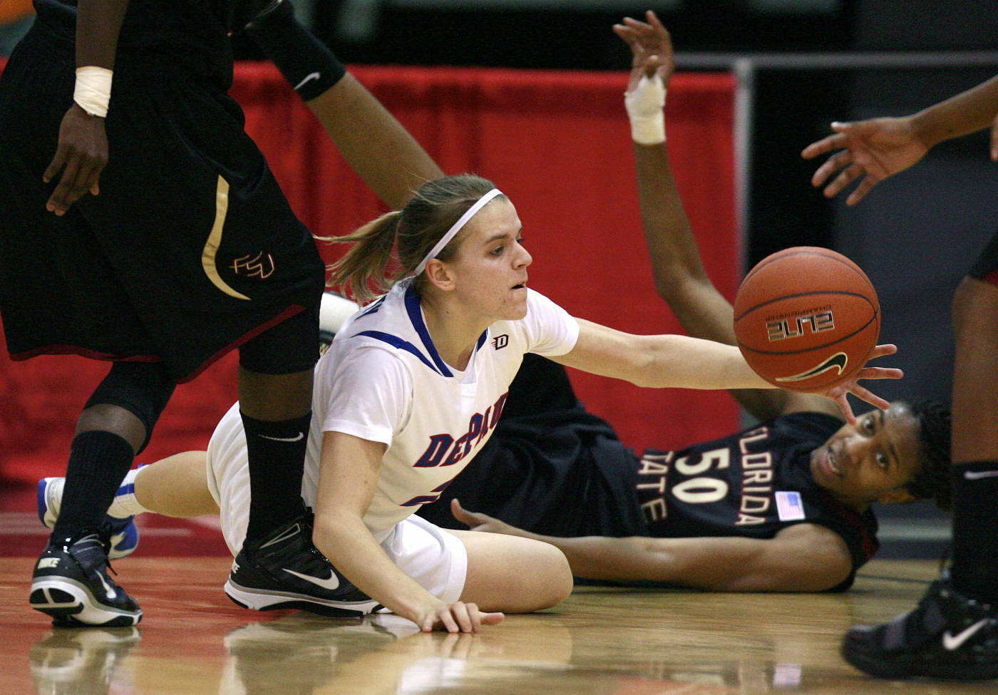 Florida State's Jacinta Monroe, right, and DePaul's Sam Quigley fight for the ball during an NCAA college basketball game in Las Vegas on Sunday, Dec. 20, 2009. (AP Photo/Eric Jamison)