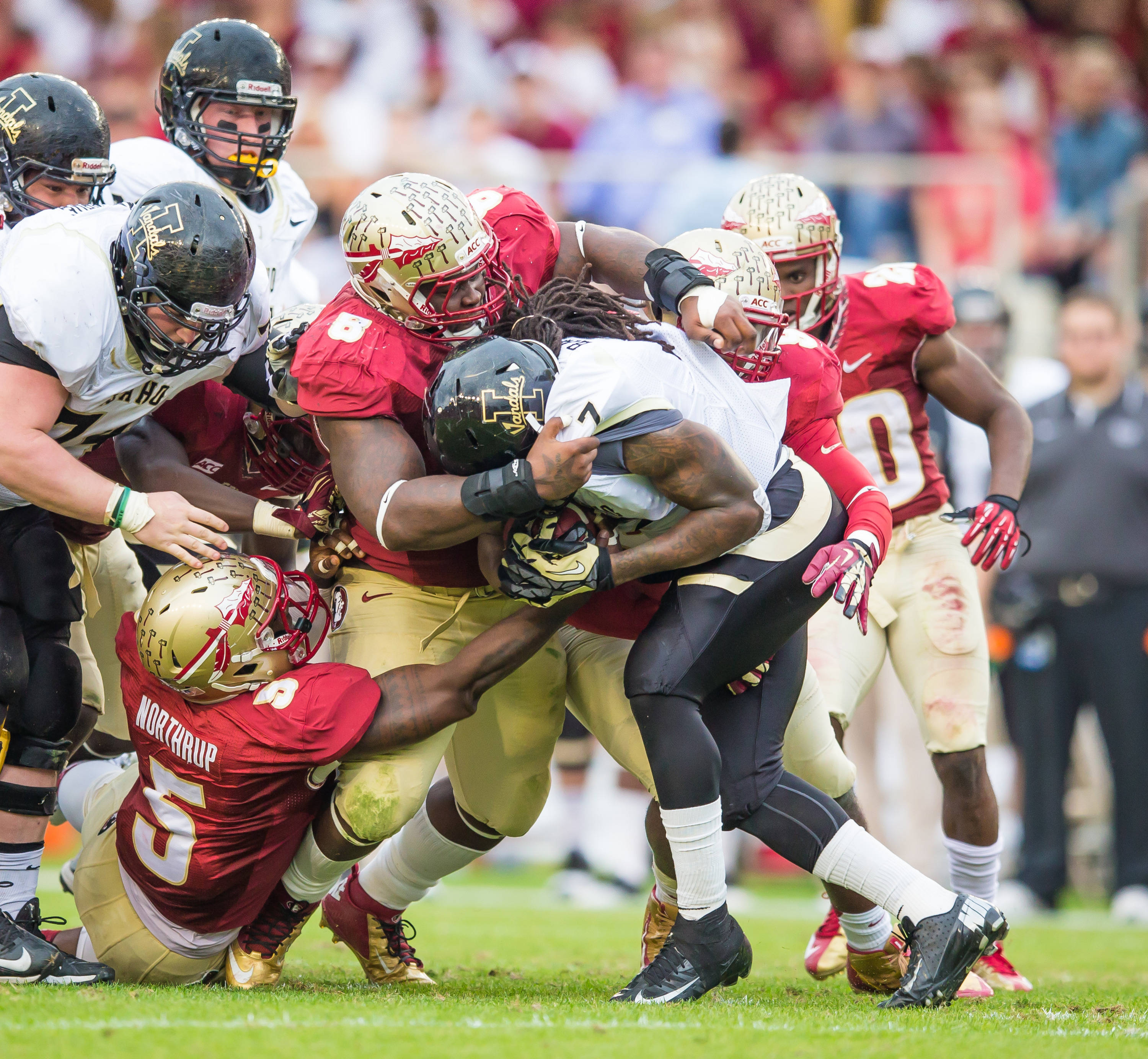 Timmy Jernigan (8) and Reggie Northrup (5) make the defensive stop.
