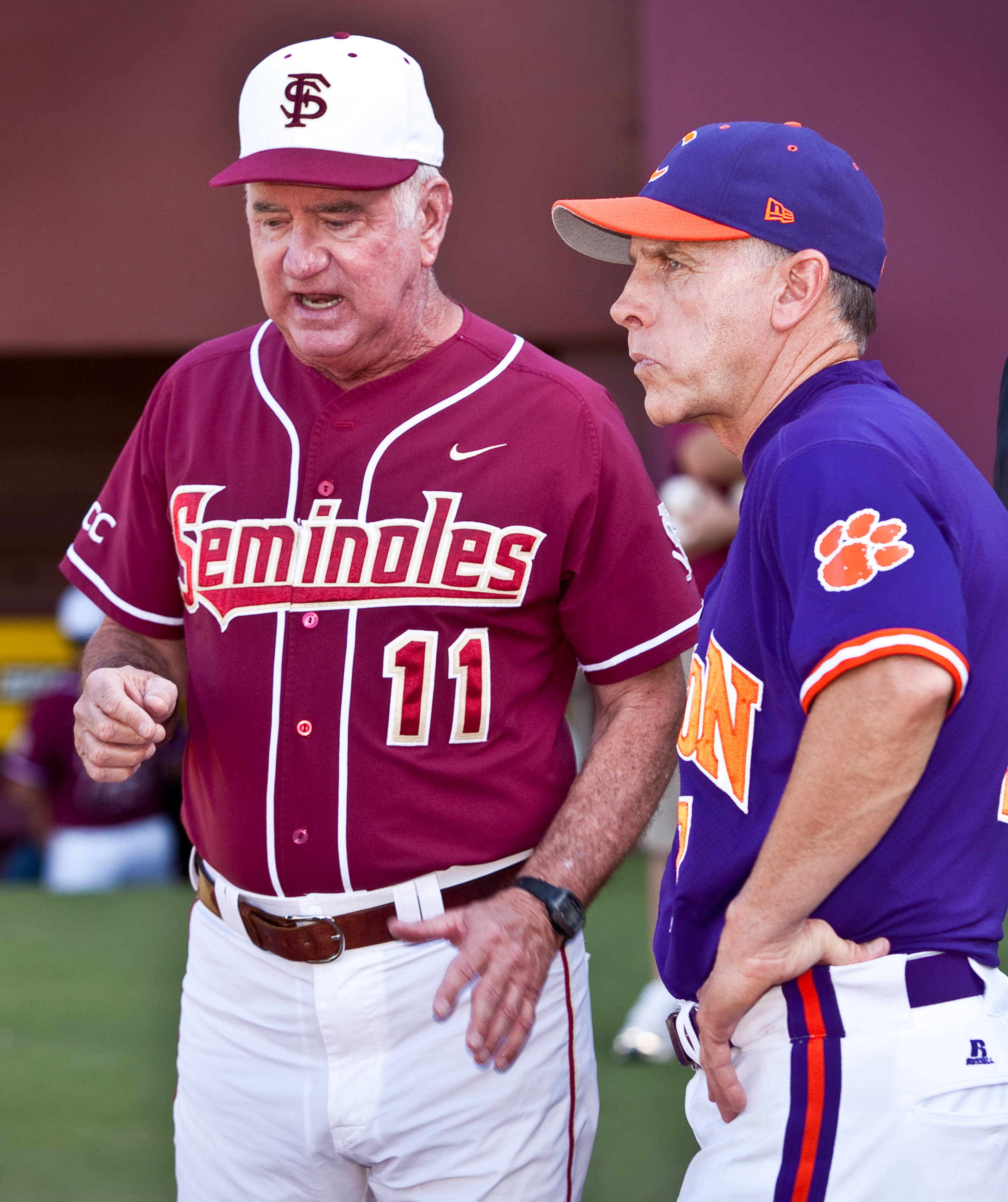Mike Martin (11) meets with Clemson's Jack Leggett