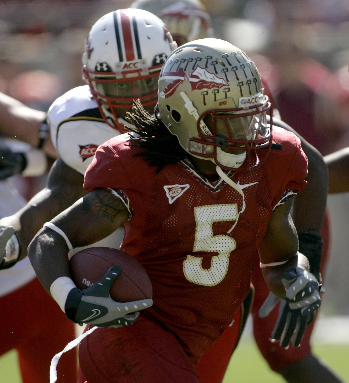 Florida State running back Preston Parker, front, runs for a first-quarter touchdown as Maryland's Erin Henderson, background, gives chase.