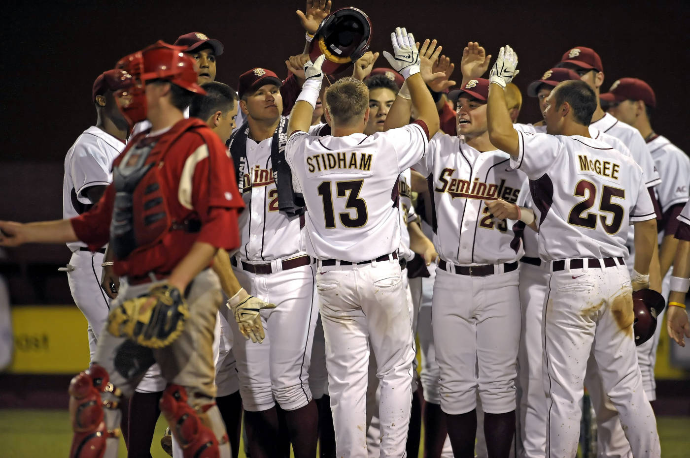 The Seminoles celebrate after a home run by Jason Stidham