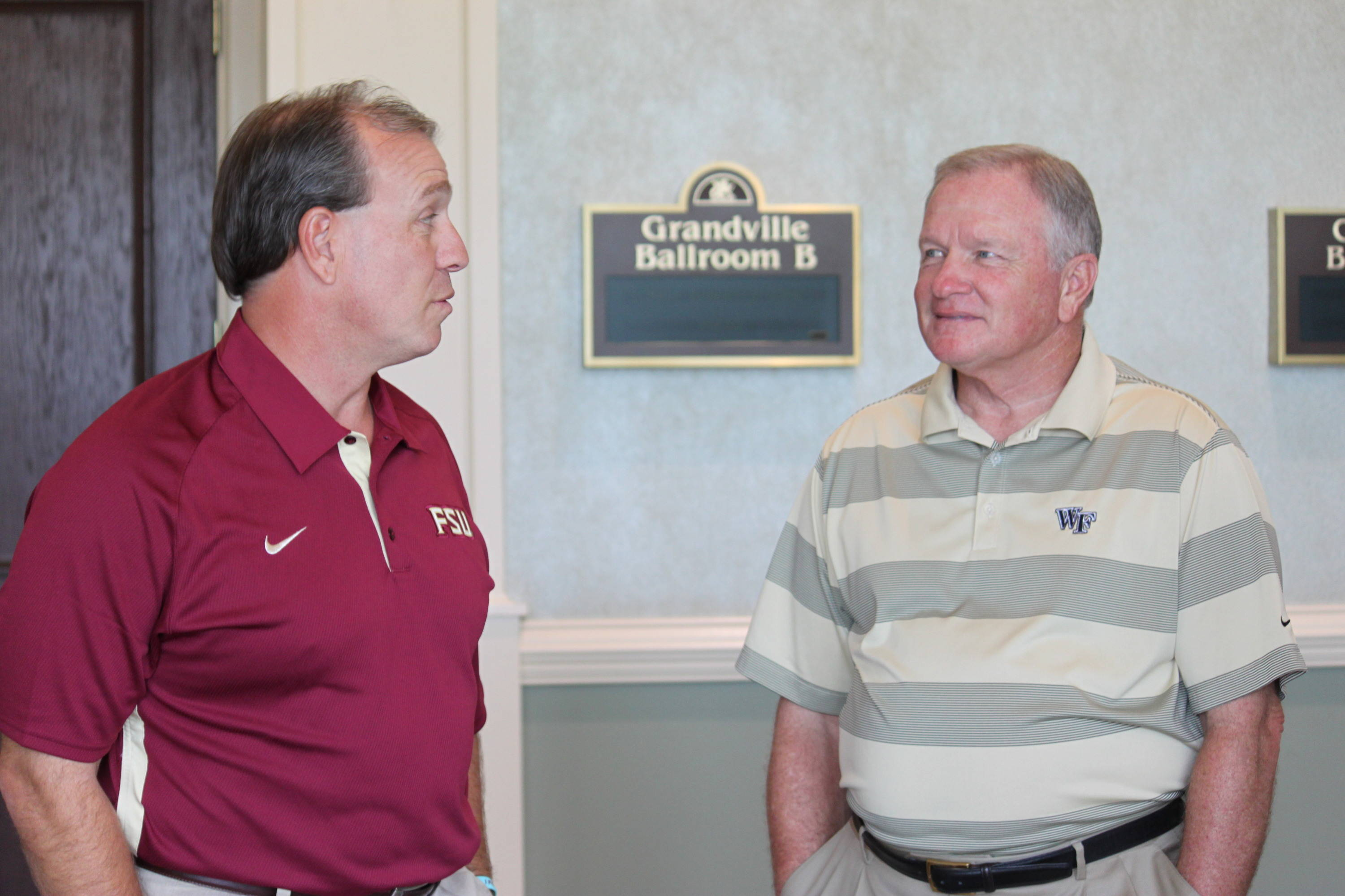 Jimbo Fisher with Wake Forest's Jim Grobe