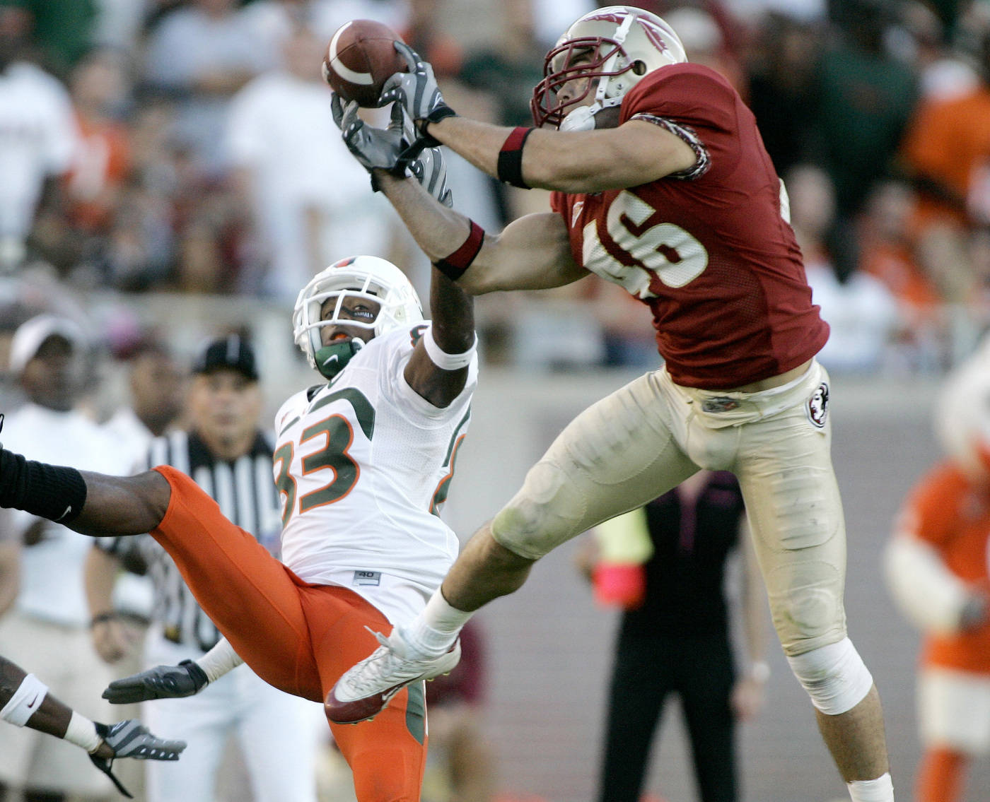 Florida State's Anthony Houllis, right, intercepts a pass intended for Miami's Sam Shields during the third quarter. (AP Photo/Phil Coale)