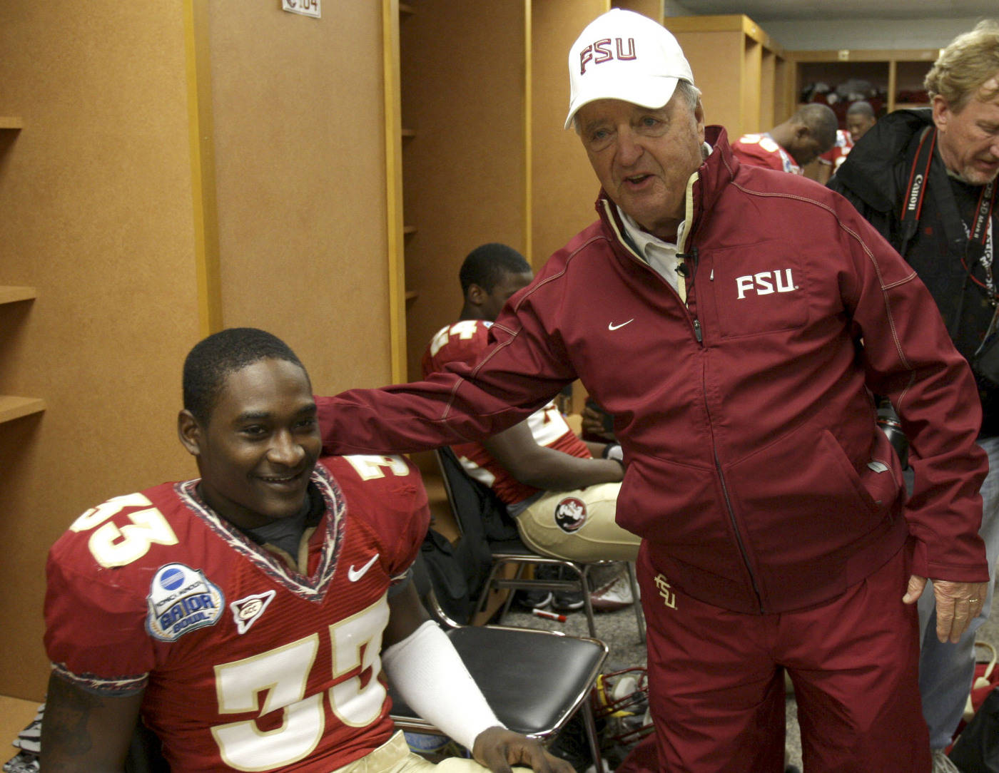 Florida State head coach, Bobby Bowden, right, visits withrunning back Ty Jones in the locker room prior to the Gator Bowl NCAA college football game against West Virginia, Friday, Jan. 1, 2010, in Jacksonville, Fla.(AP Photo/Phil Coale)