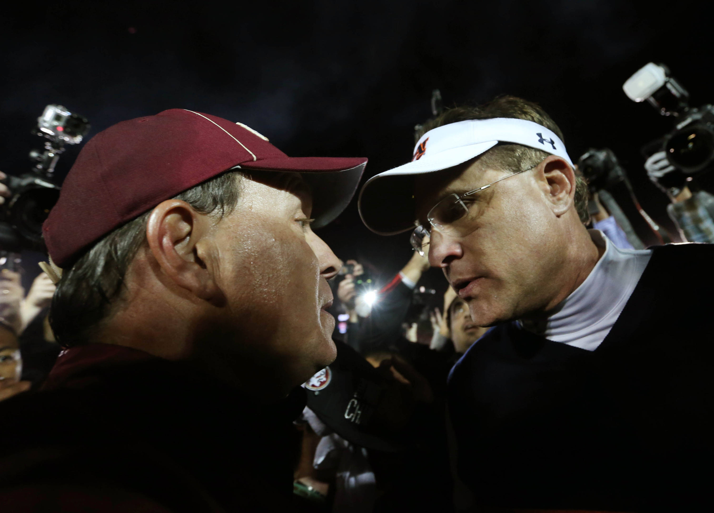 Jan 6, 2014; Pasadena, CA, USA; Auburn Tigers head coach Gus Malzahn (right) congratulates Florida State Seminoles head coach Jimbo Fisher (left) during the second half of the 2014 BCS National Championship game at the Rose Bowl.  Mandatory Credit: Matthew Emmons-USA TODAY Sports