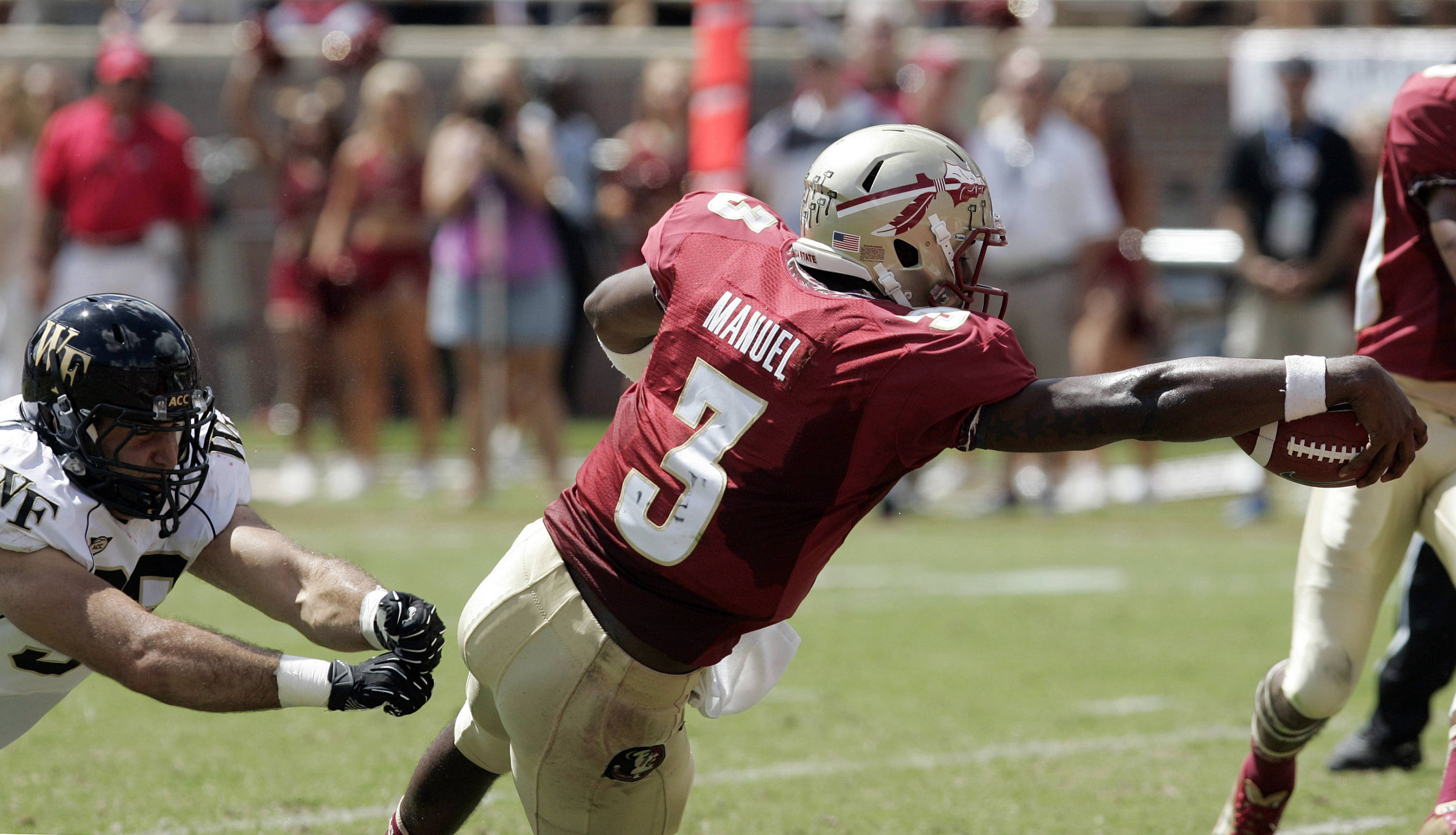 Florida State's EJ Manuel extends the ball over the goal line as he escapes the grasp of Wake Forest's Scott Betros to score. (AP Photo/Steve Cannon)