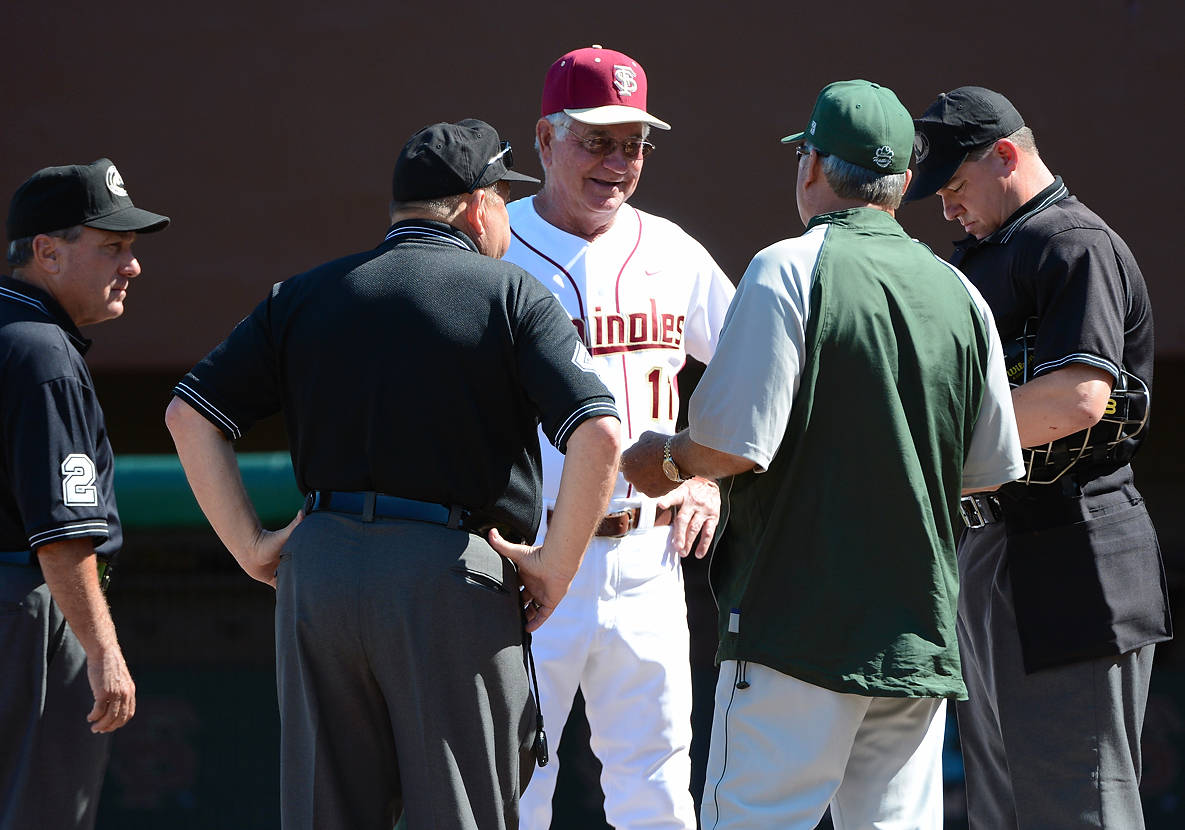 FSU head coach Mike Martin and Stetson head coach Pete Dunn talk to the umpires prior to the start of Wednesday's game.