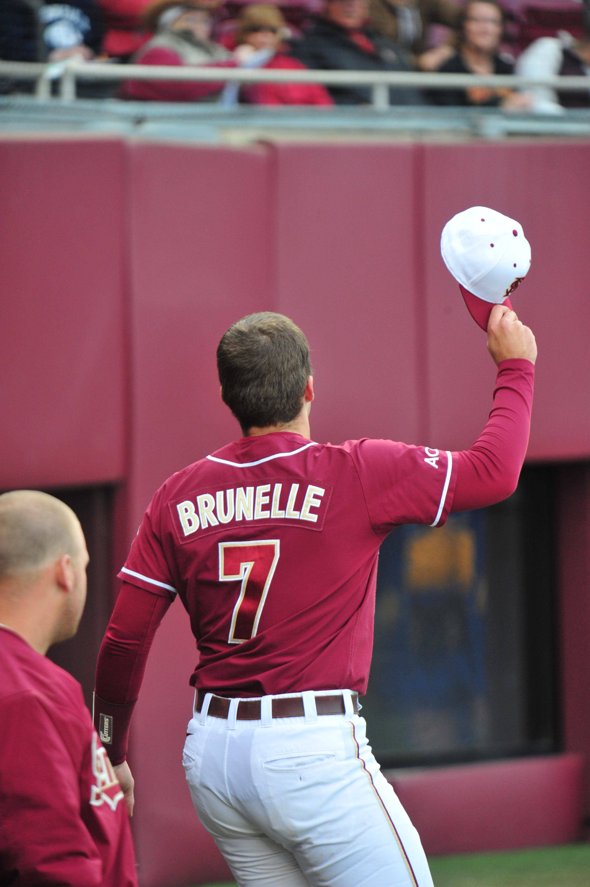 Parker Brunelle acknowledges the ground after hitting his first home run of the season.