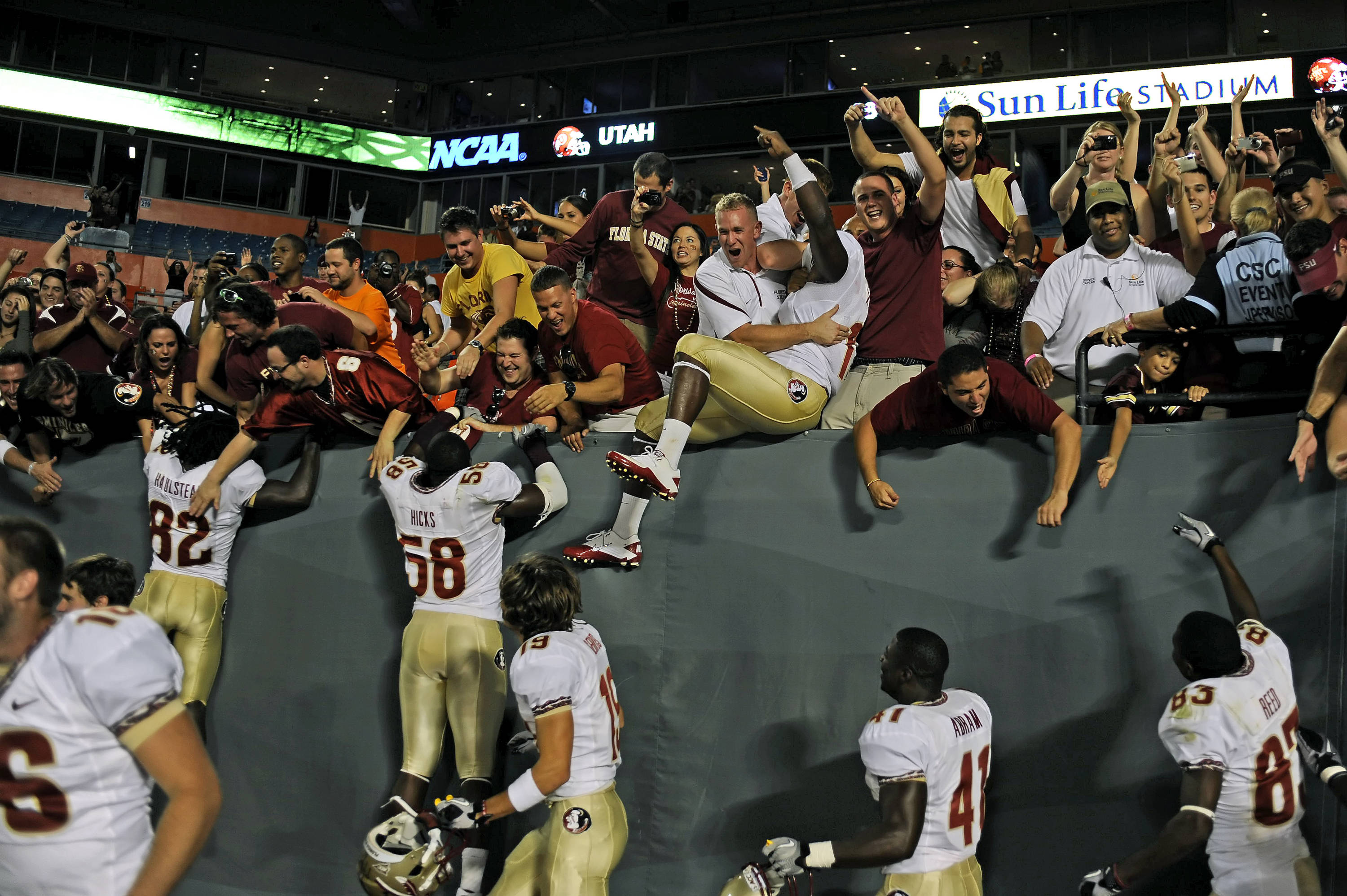 Players celebrate with exuberant fans after the Seminoles defeated Miami 45-17.